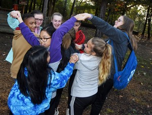 LOCK leadership students play an icebreaker game in which they must untangle their arms without letting go.
