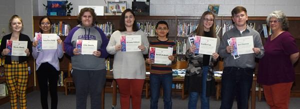 Campbellsville Middle School students were recently inducted as charter members of the CMS National Junior Art Honor Society. Members were honored at a special ceremony recently. They are, from left, eighth-graders Alexis Sharp and Angelica Seng, seventh-grader Zeke Harris, eighth-grader Brianna Dobson, seventh-grader Jacob DeBrot and eighth-graders Karlie Cox and Jovi Bowen, pictured with art teacher Jo Ann Harris. Absent from the photo is seventh-grader Kyra Parker.