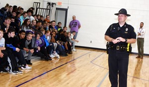 Campbellsville Police Officer Jake Hedgespeth speaks to Campbellsville Middle School students about the dangers of using illegal drugs, as part of Red Ribbon Week.