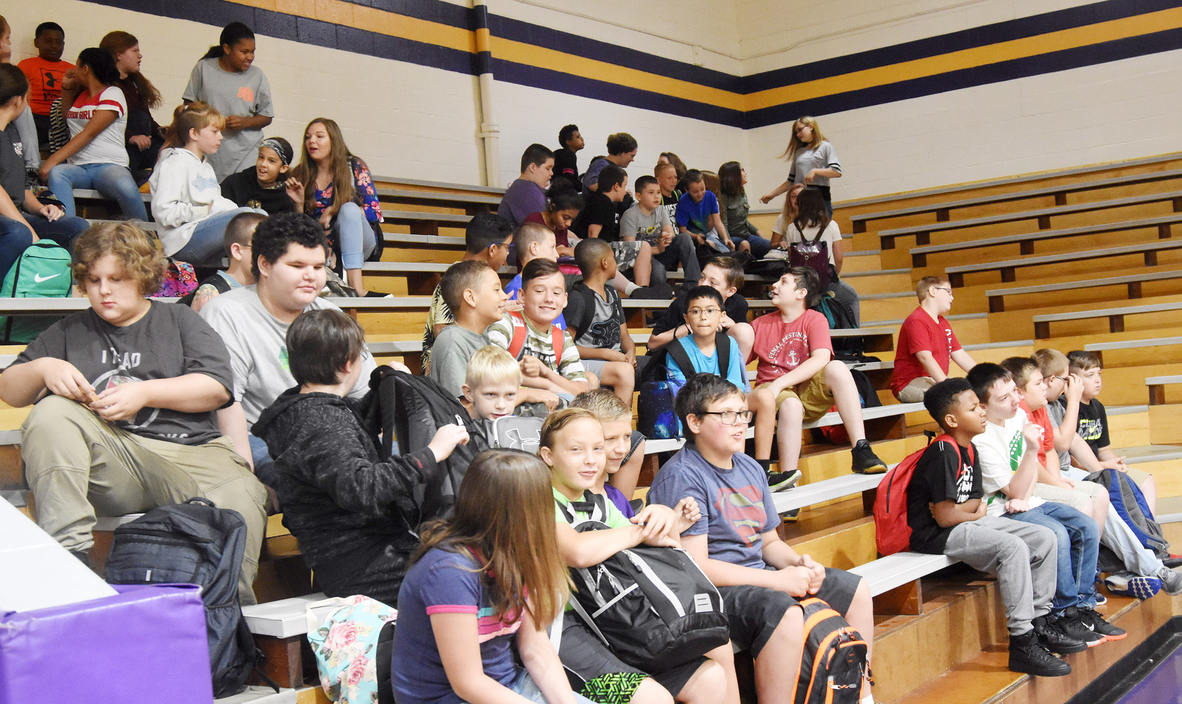 CMS students wait in the gym for the school day to start.