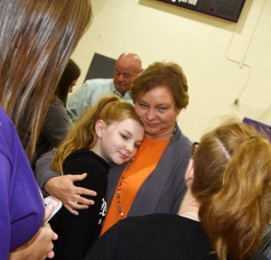 CMS teacher Sharon Shults hugs seventh-grader Morgan Spears.