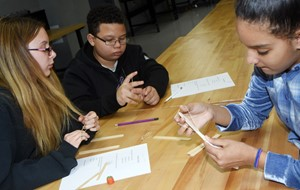 From left, CMS sixth-graders Vivian York, Toby Adams and Aleecia Knezevic build their catapult.