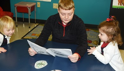 iEagle sixth-grader Ryder Murphy reads to KCA students.