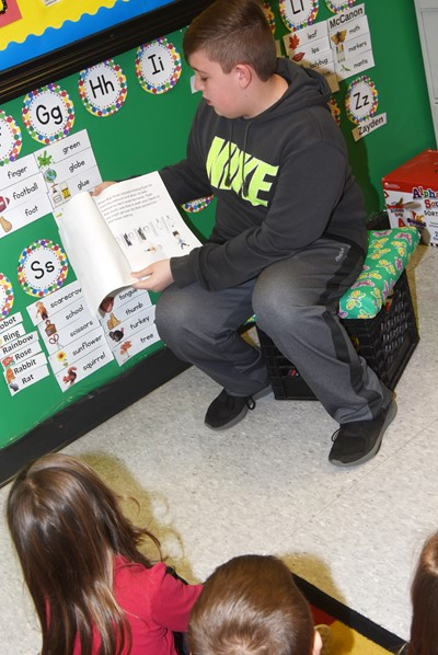 iEagle seventh-grader Skylar Wilhoite reads to KCA students.