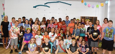 Fourth- and fifth-grade iEagle students smile for a photo on the first day of their program.