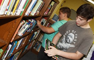 iEagle seventh-grader Andrew Mardis browses the books at Campbellsville Middle School library.
