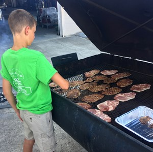 iEagle seventh-grader Rowan Petett mans the grill.