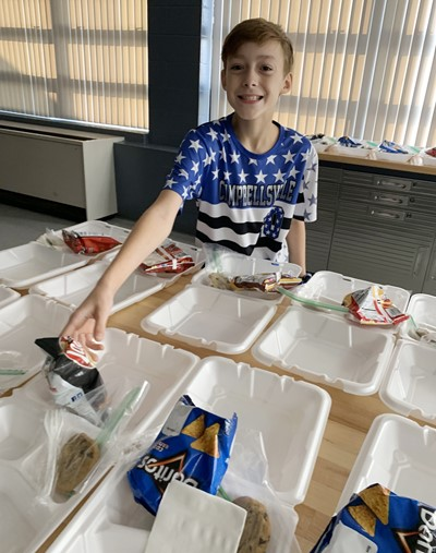 iEagle sixth-grader Caysen Wise prepares lunches.