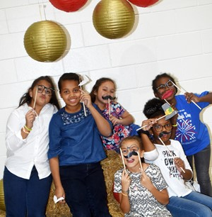 iEagle students, from left, fourth-graders Maleigha Travis, Journey Webb, Ammarissa Nunez, Londyn Smith, Willow Griffin and Destini Gholston pose for a photo together.