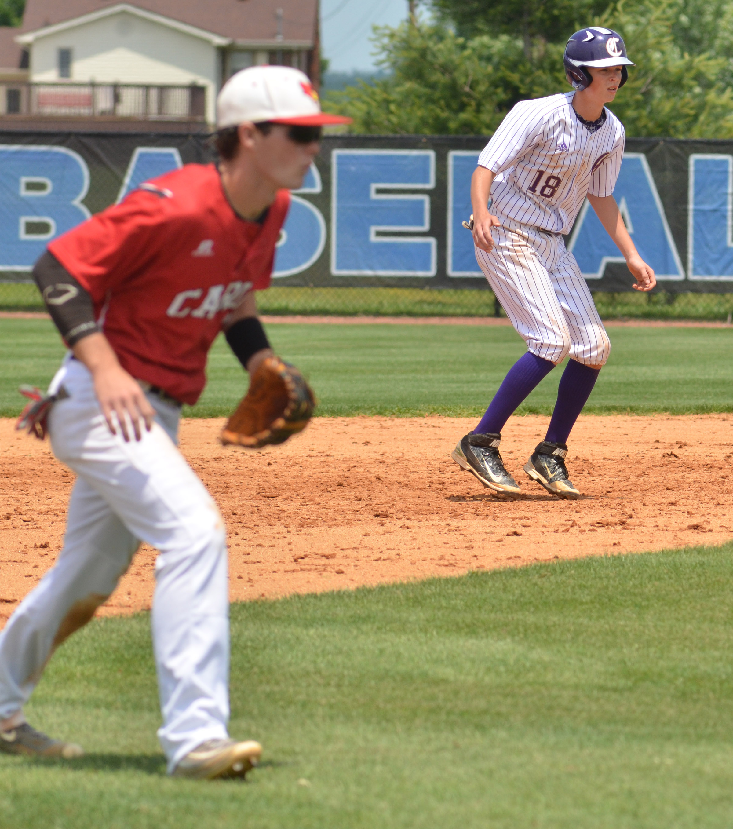 CHS freshman Noah Hughes looks to run to third.