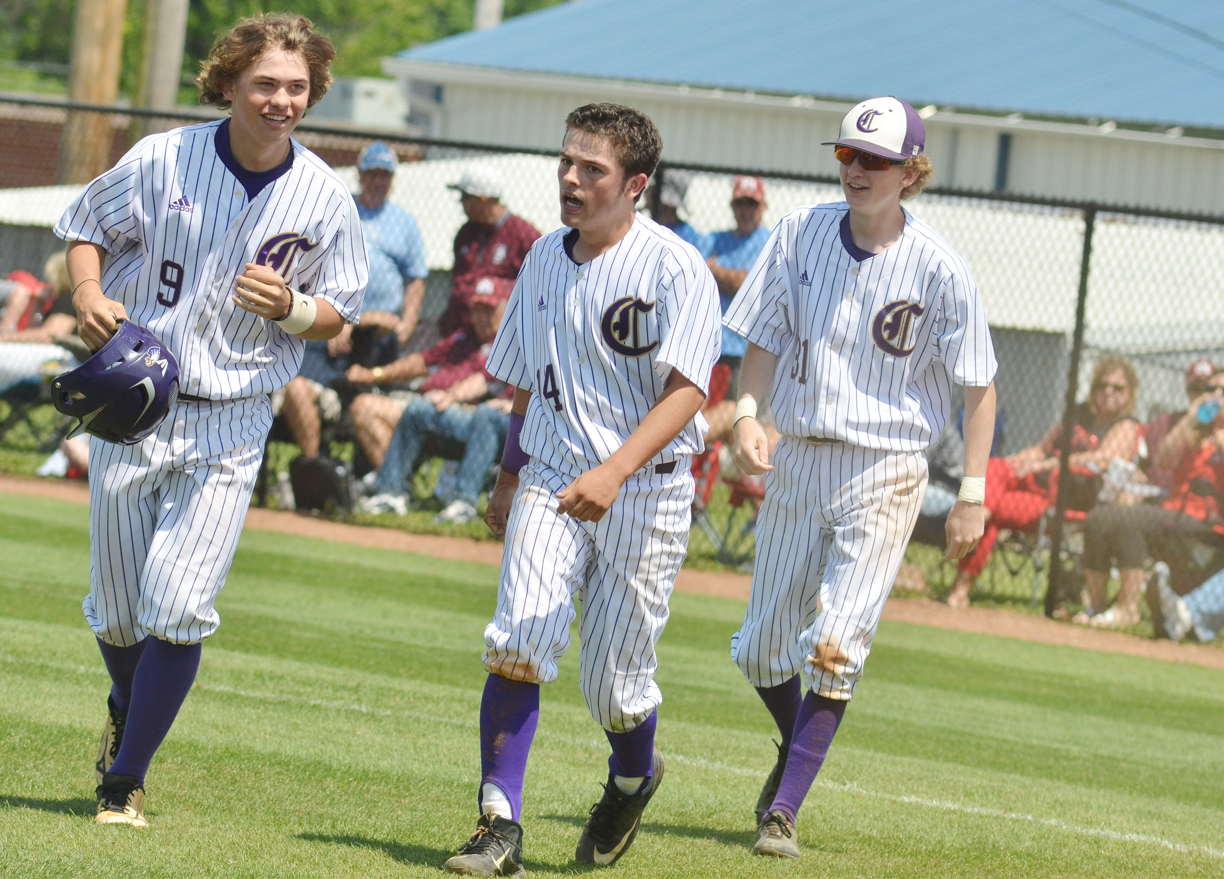 CHS sophomore Treyce Mattingly, at left, celebrates with teammates Ryan Kearney, center, and Jackson Hinton, also sophomores, after hitting a three-run homerun.