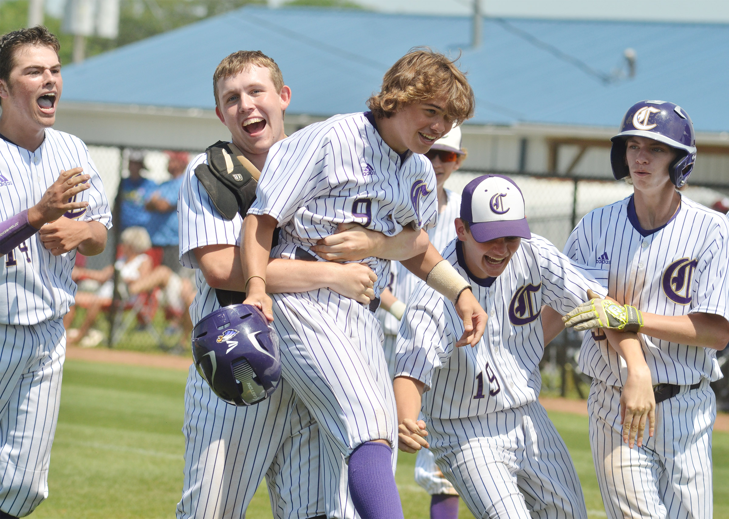 CHS senior Jared Brewster picks up Treyce Mattingly, a sophomore, after Mattingly hit a three-run homerun. Also pictured are sophomore Ryan Kearney, at left, and freshman Blake Allen, second from right, and Campbellsville Middle School eighth-grader Arren Hash.