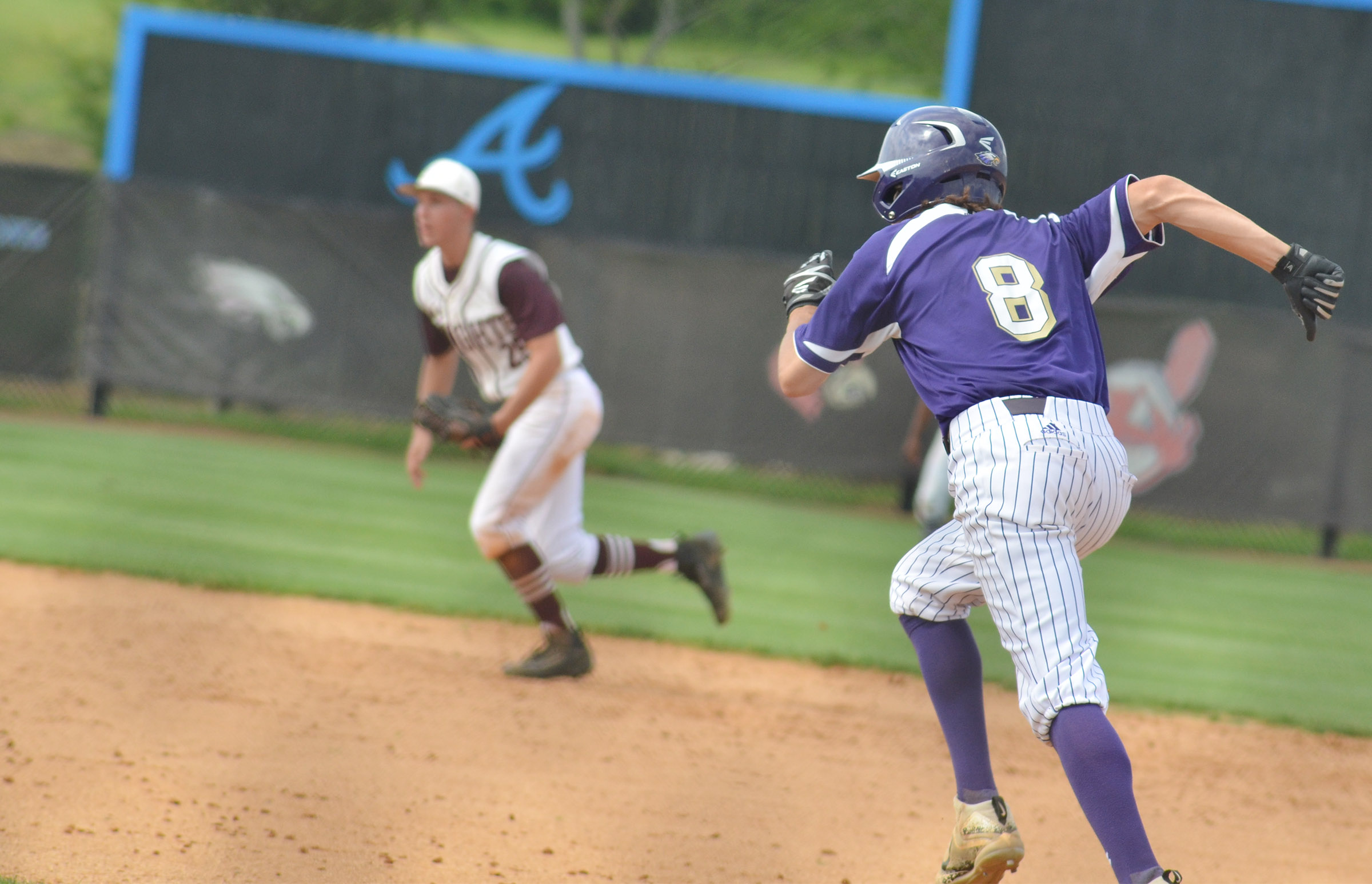 Campbellsville Middle School eighth-grader John Orberson steals second.