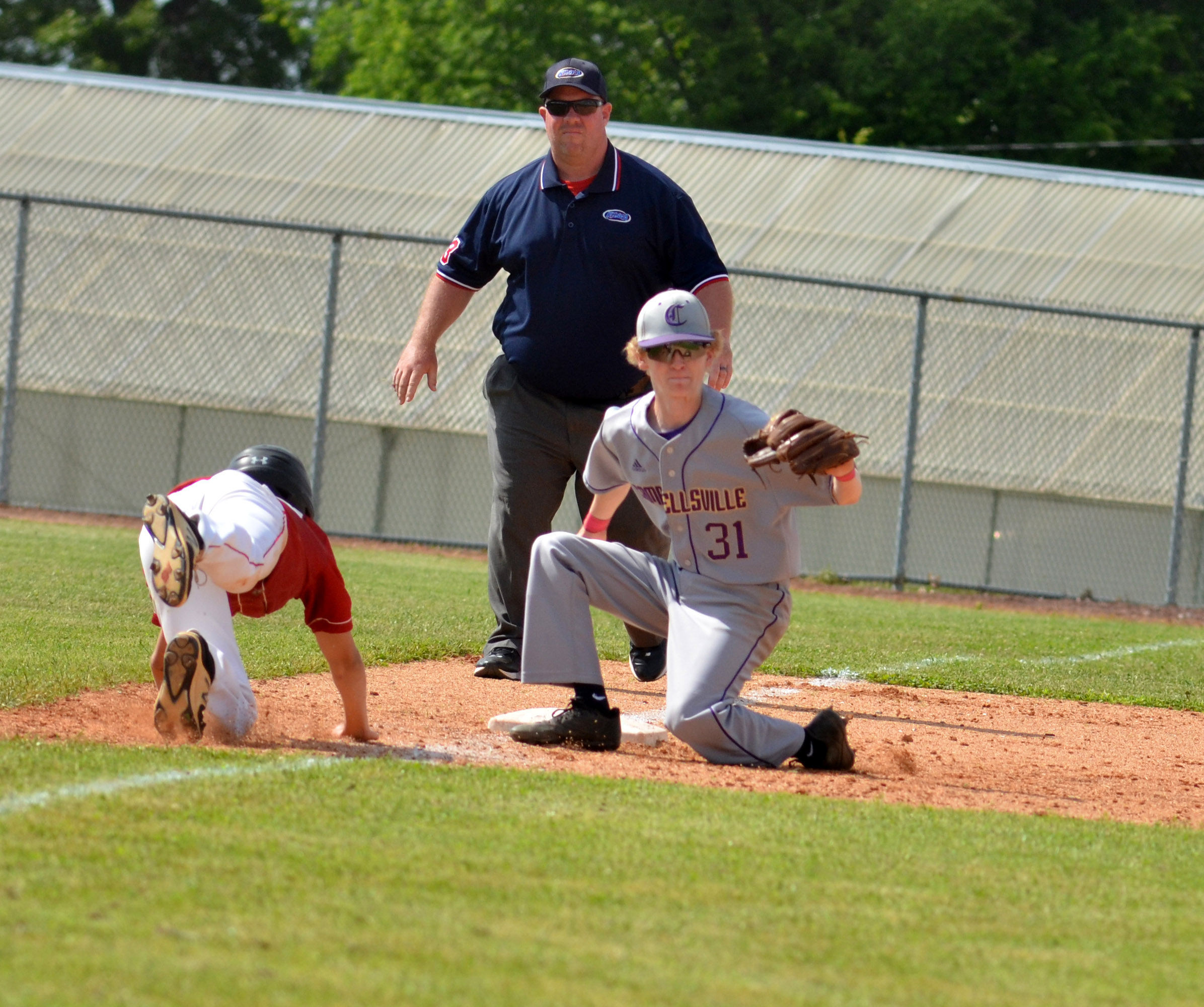 CHS sophomore Jackson Hinton picks the runner of third.
