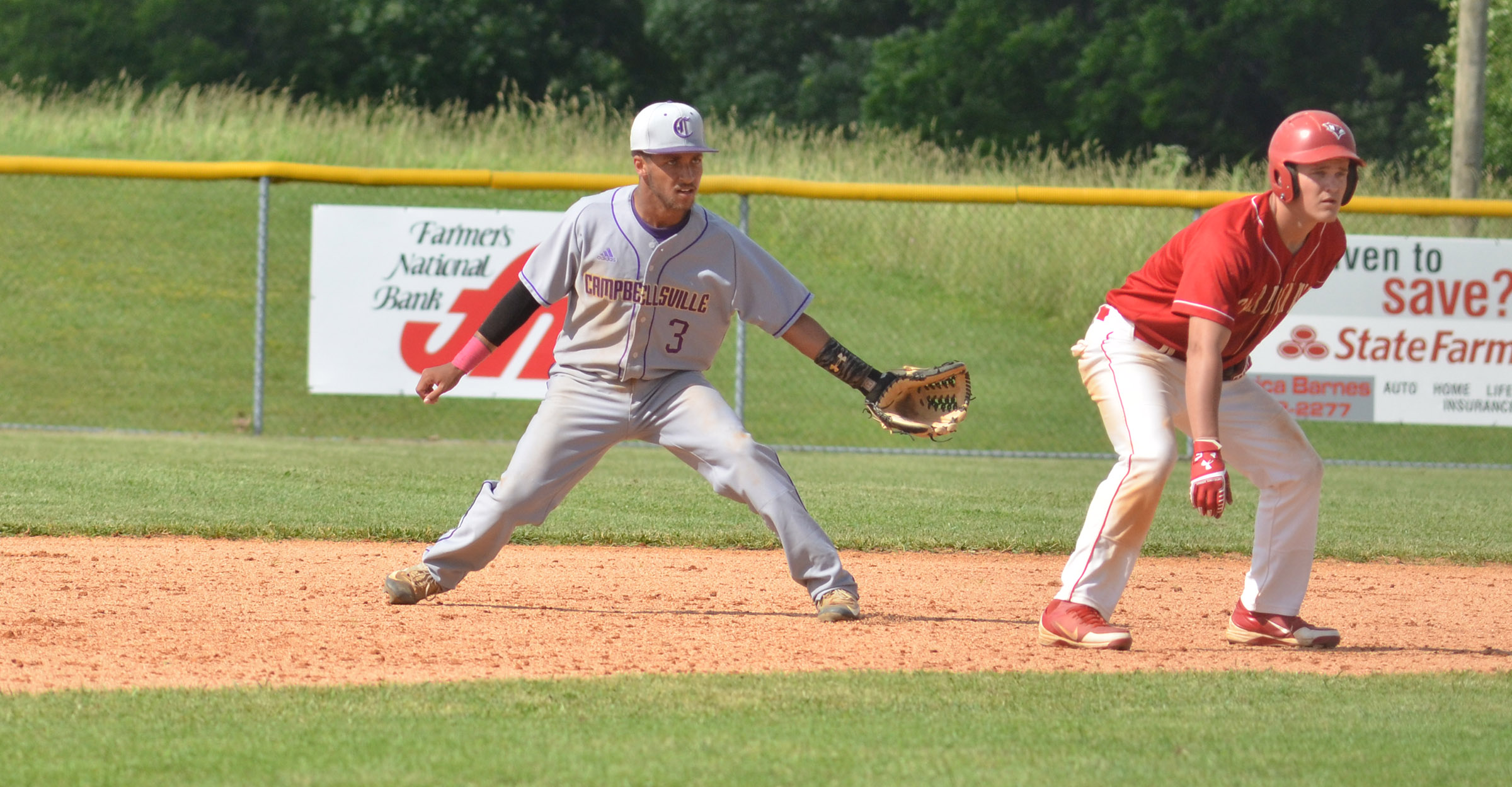 CHS junior Ethan Lay keeps the runner close at second.