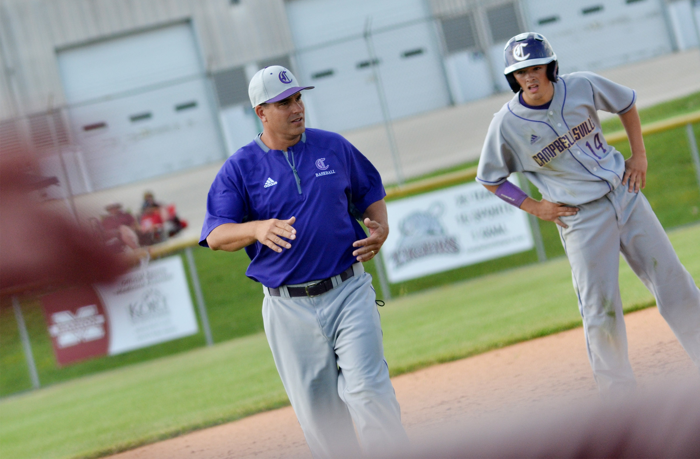 CHS head baseball coach Kirby Smith talks to sophomore Ryan Kearney.