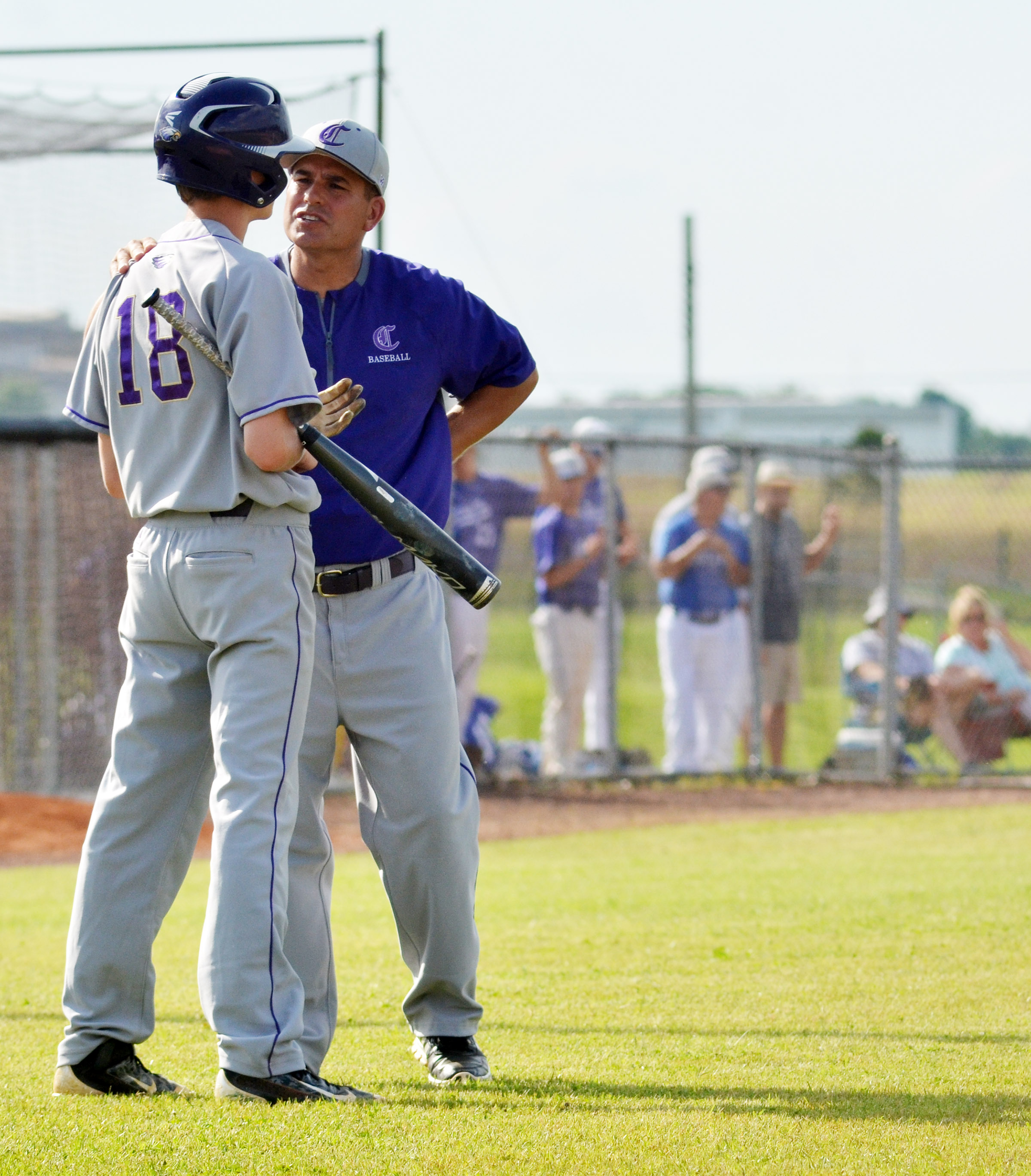 CHS head baseball coach Kirby Smith talks to freshman Noah Hughes.