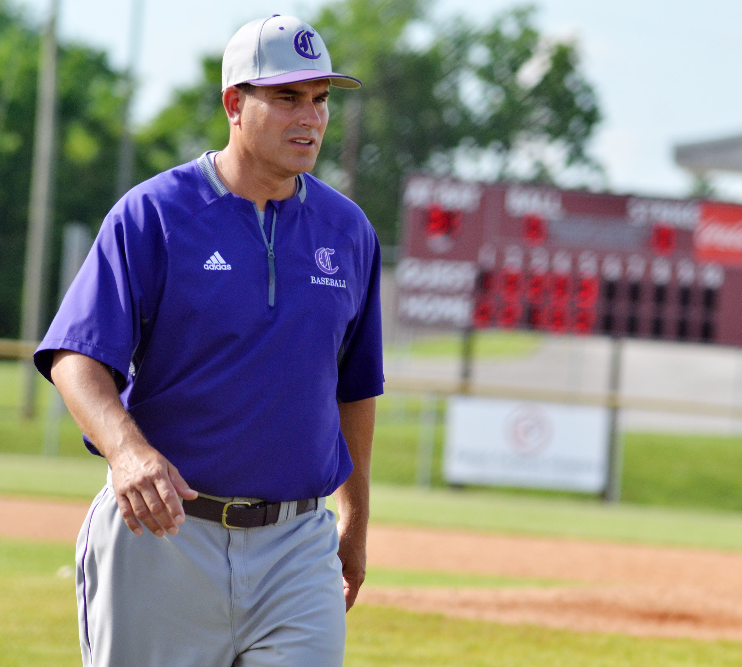 CHS head baseball coach Kirby Smith walks to the dugout.