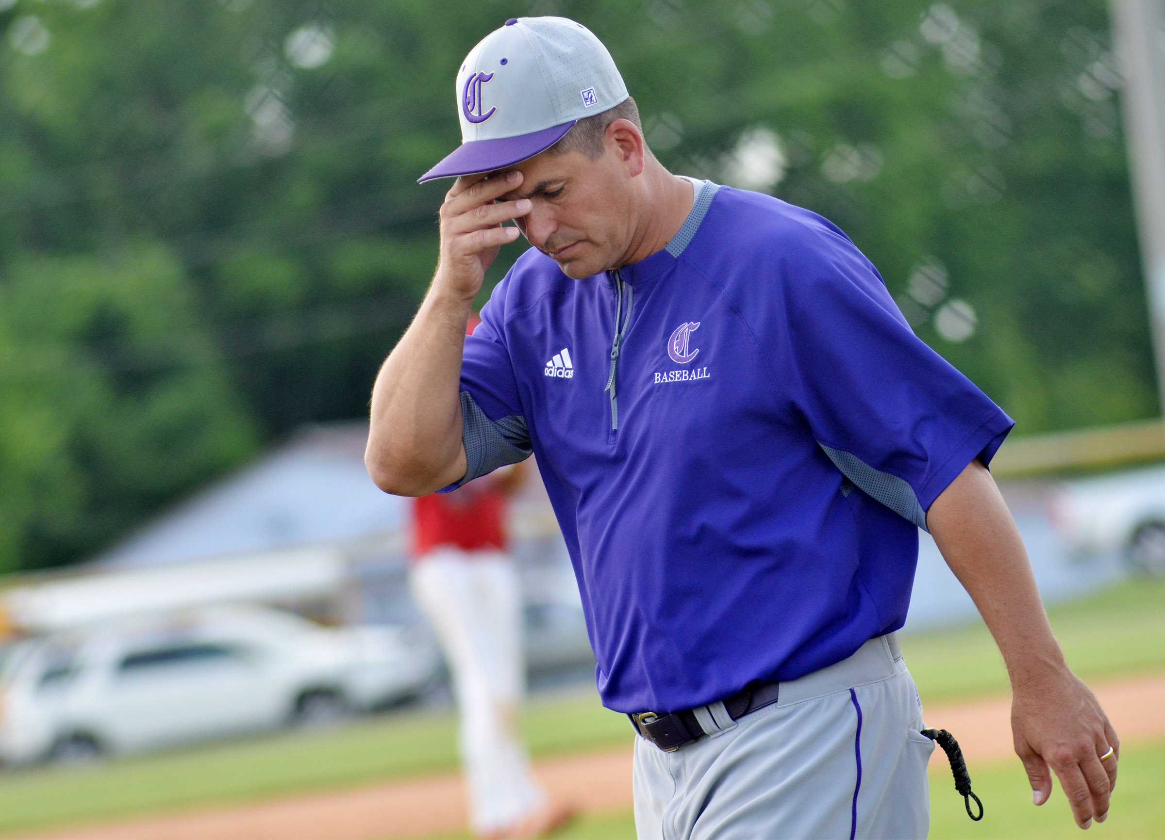 CHS head baseball coach Kirby Smith shows frustration as his team loses the lead.