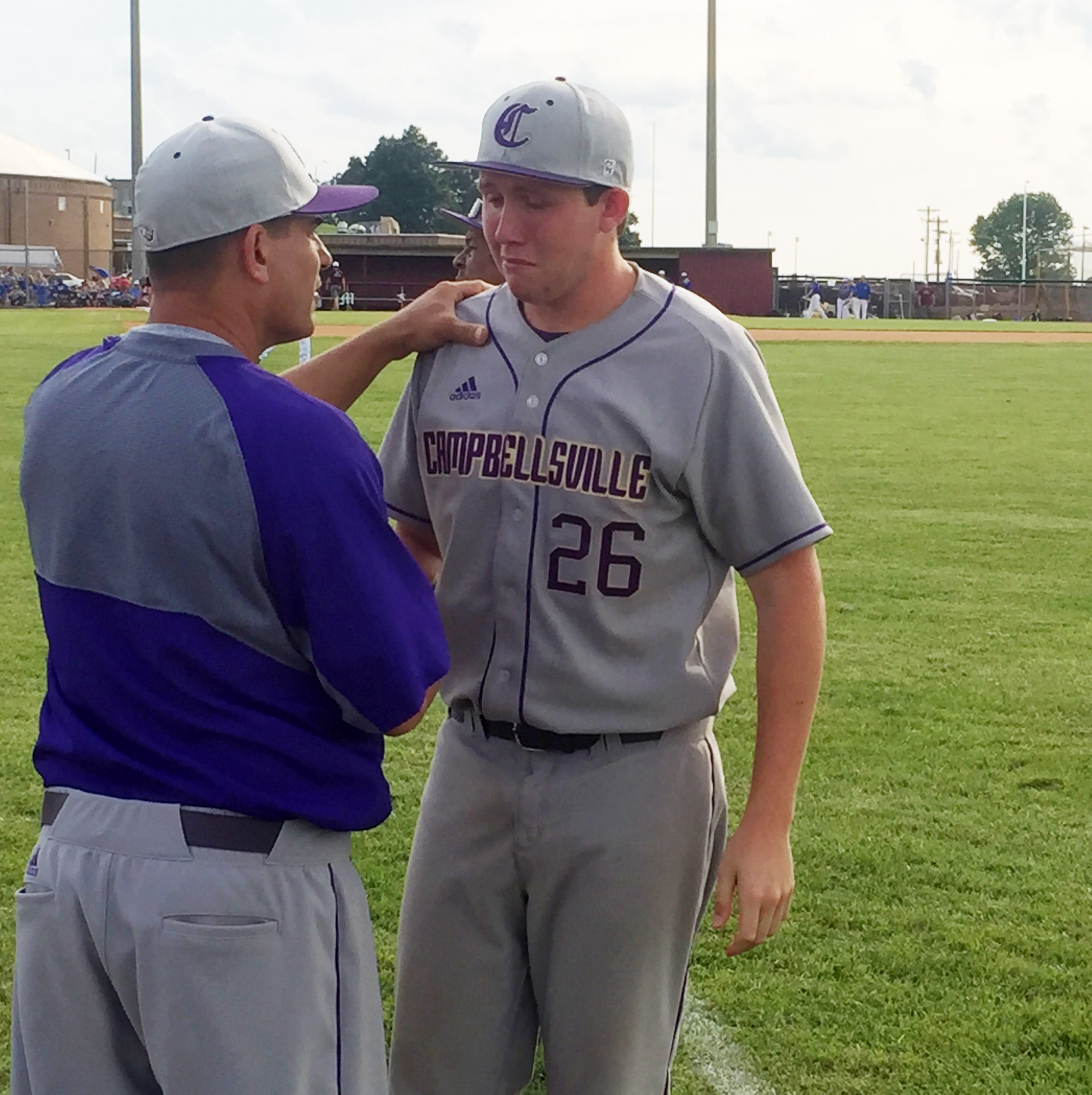 CHS head baseball coach Kirby Smith thanks senior Jared Brewster for his leadership and dedication to his team.