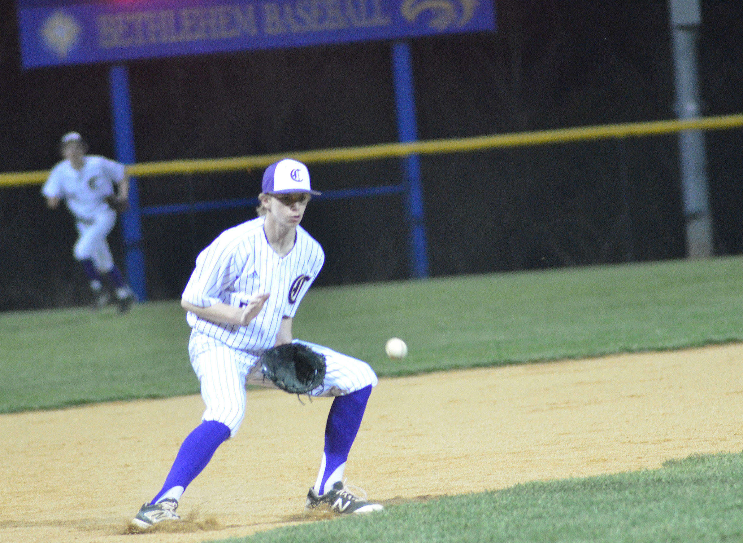 Campbellsville Middle School eighth-grader Arren Hash fields the ball for an out.