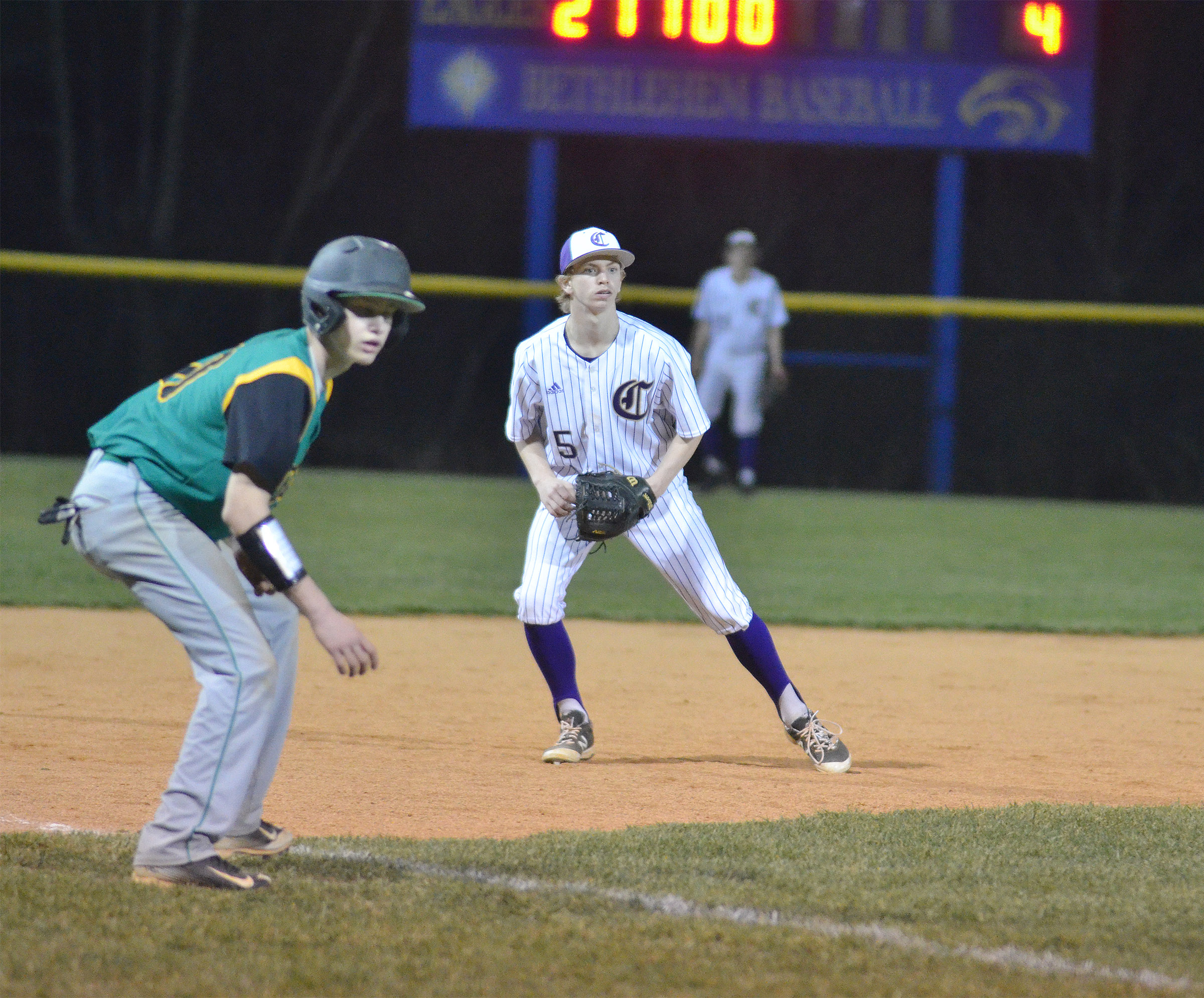 Campbellsville Middle School eighth-grader Arren Hash watches the runner on third.