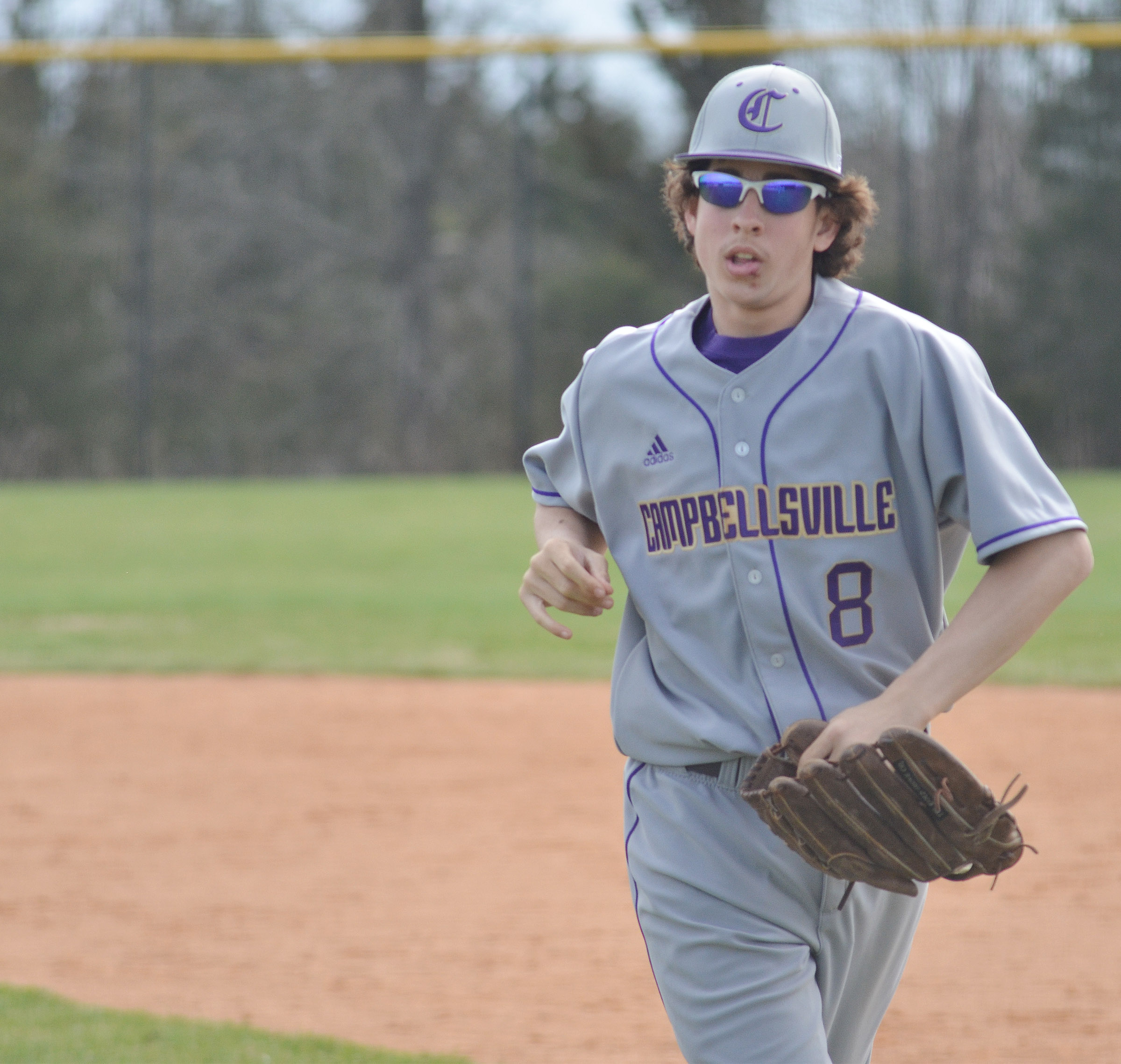 Campbellsville Middle School eighth-grader John Orberson runs to the dugout.