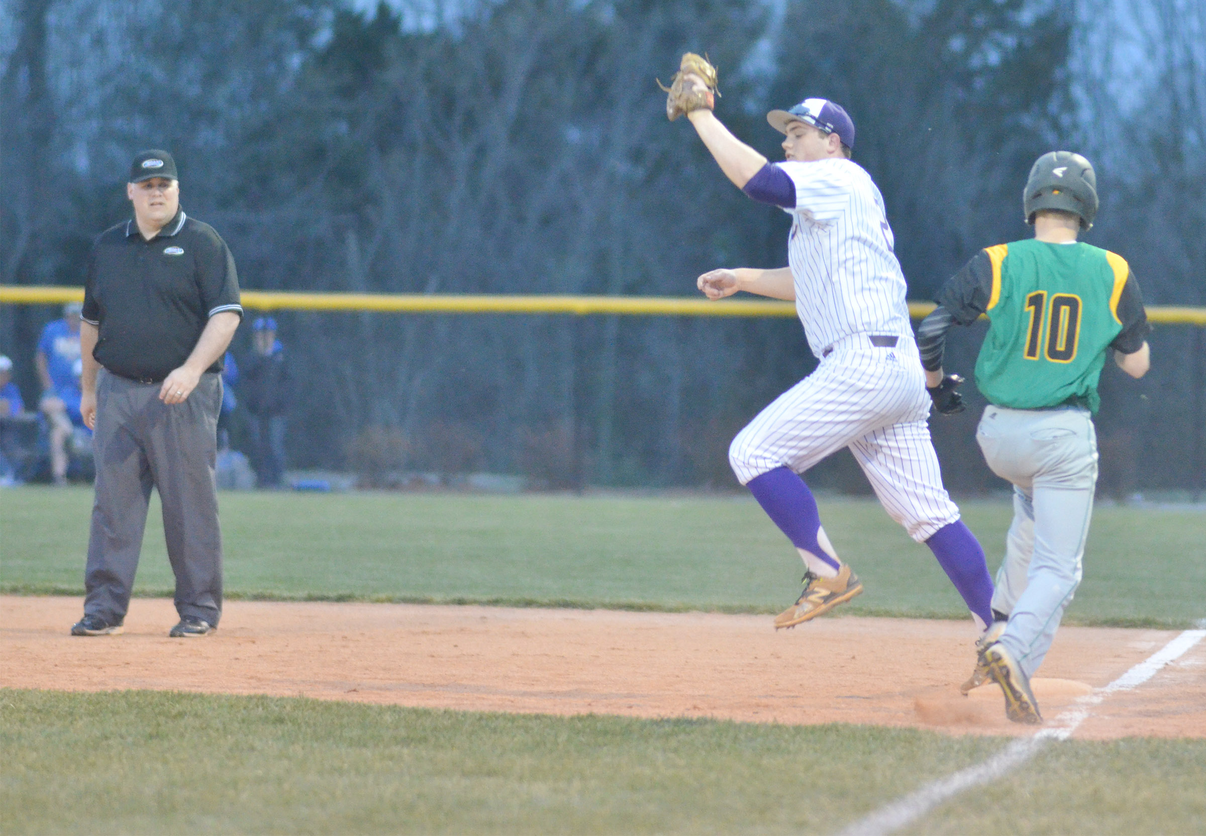 CHS sophomore Lane Bottoms gets an out at first.