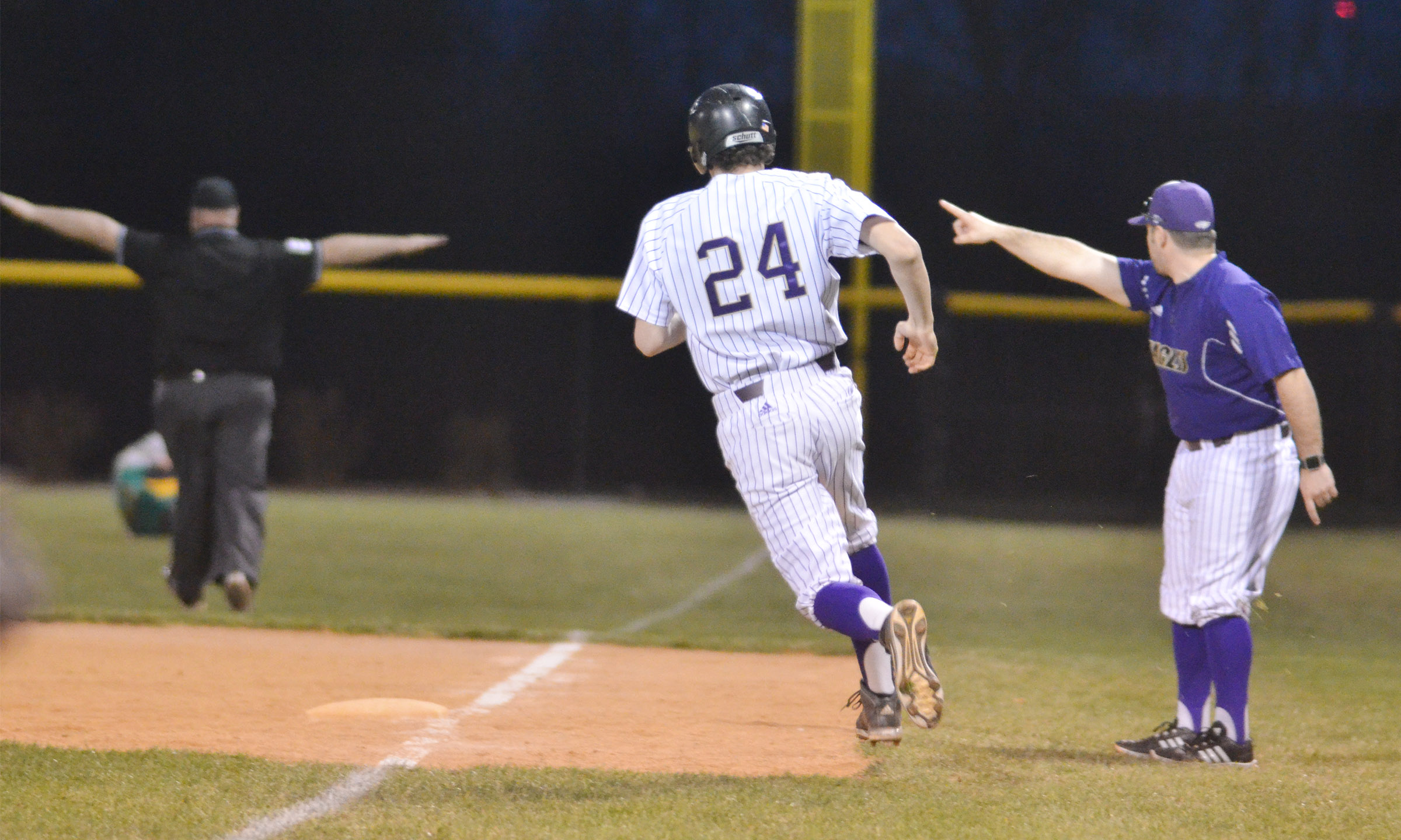 CHS assistant baseball coach Blake Milby tells freshman Brennon Wheeler to run to second.