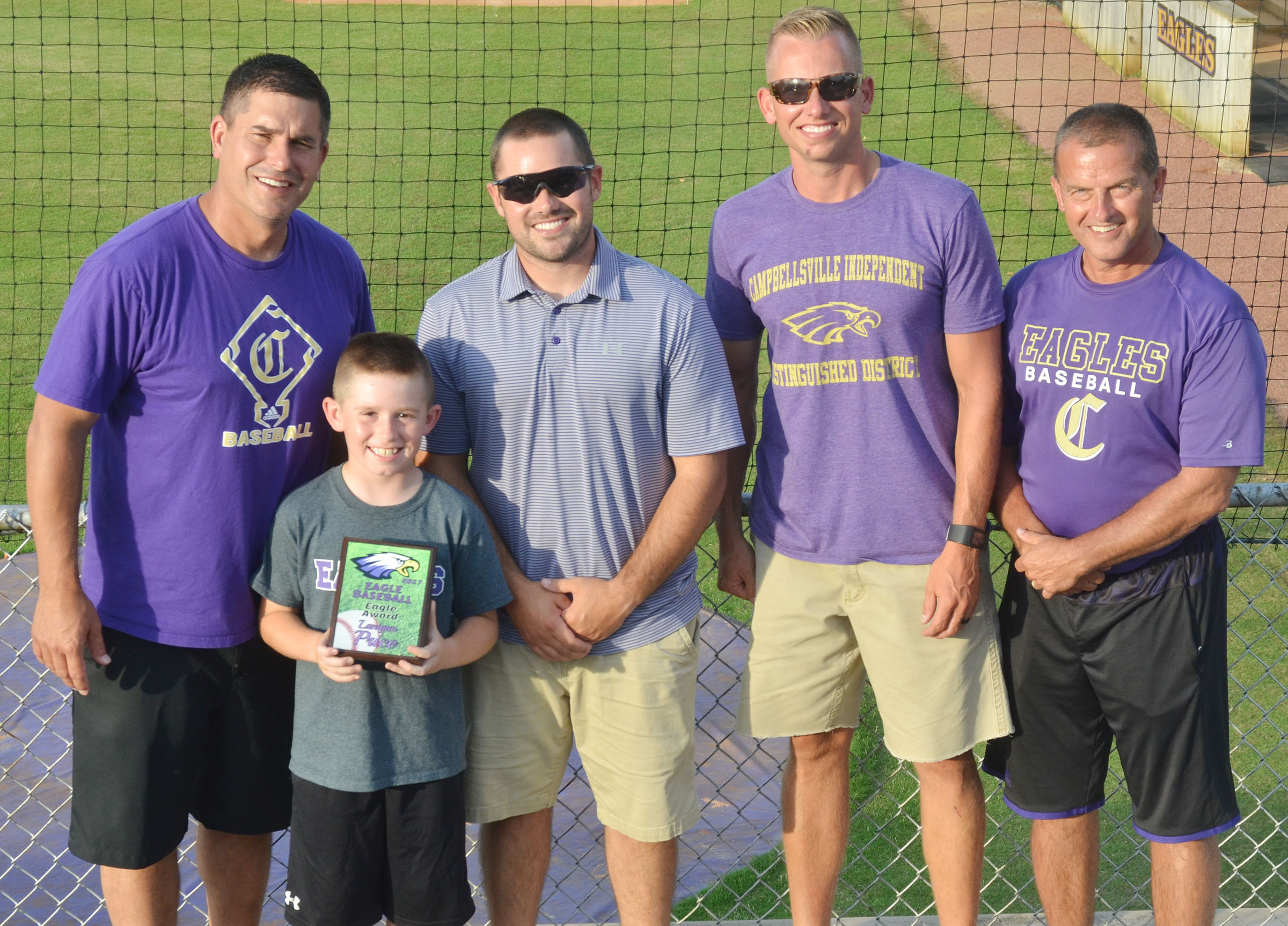Campbellsville Elementary School second-grader Lanigan Price received an Eagle Award for being the team's bat boy. From left are head coach Kirby Smith and assistant coaches Blake Milby, Zach Lewis and Lynn Kearney. Absent from the photo is assistant coach Phil Gowdy.