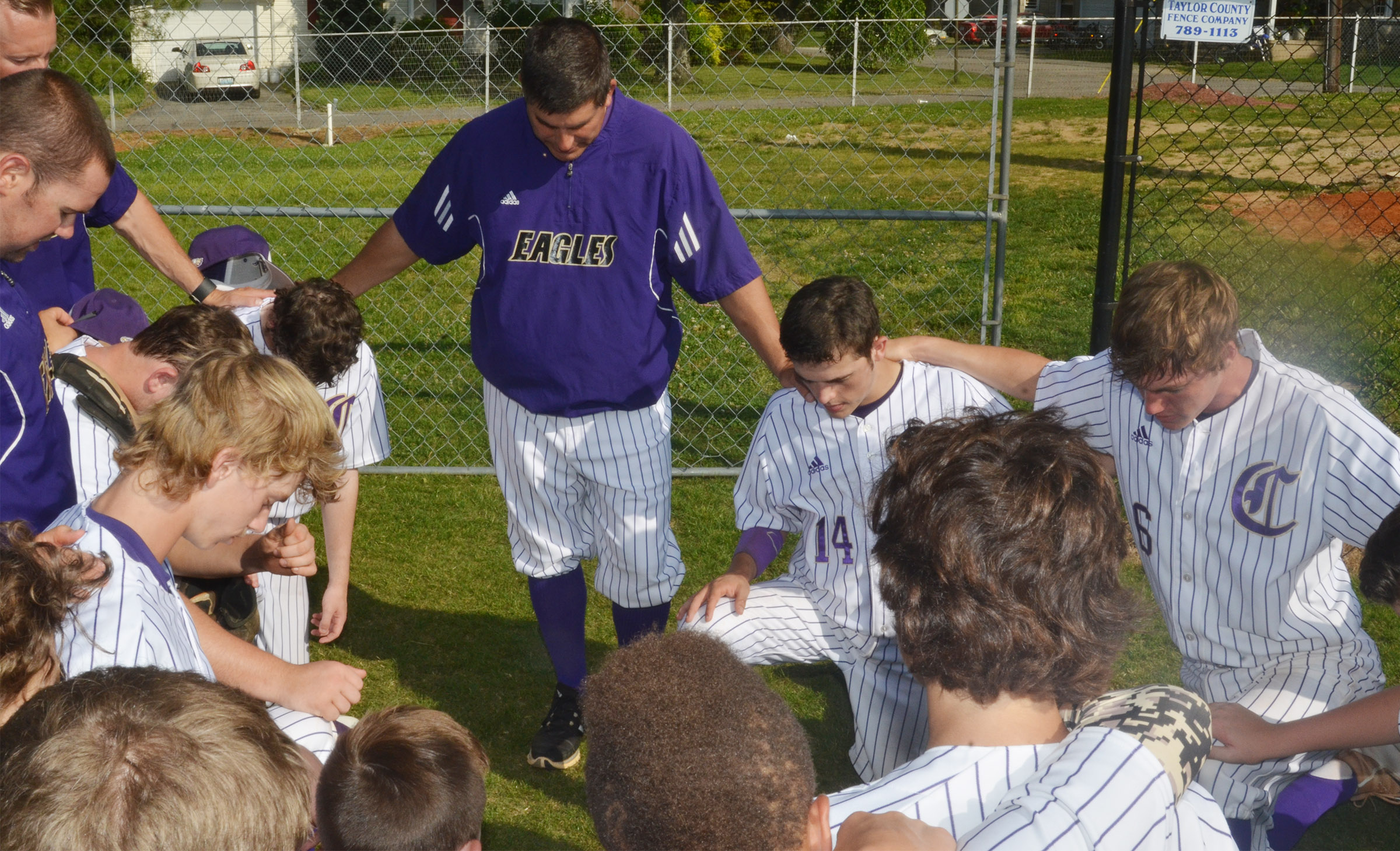 CHS head baseball coach Kirby Smith leads his team in prayer before taking on Washington County.