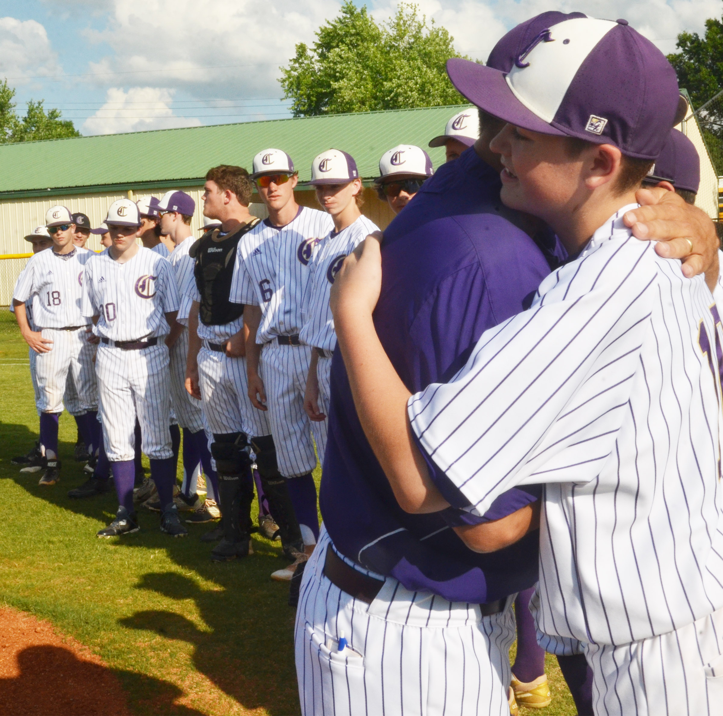 CHS head baseball coach Kirby Smith hugs freshman Gavin Johnson.