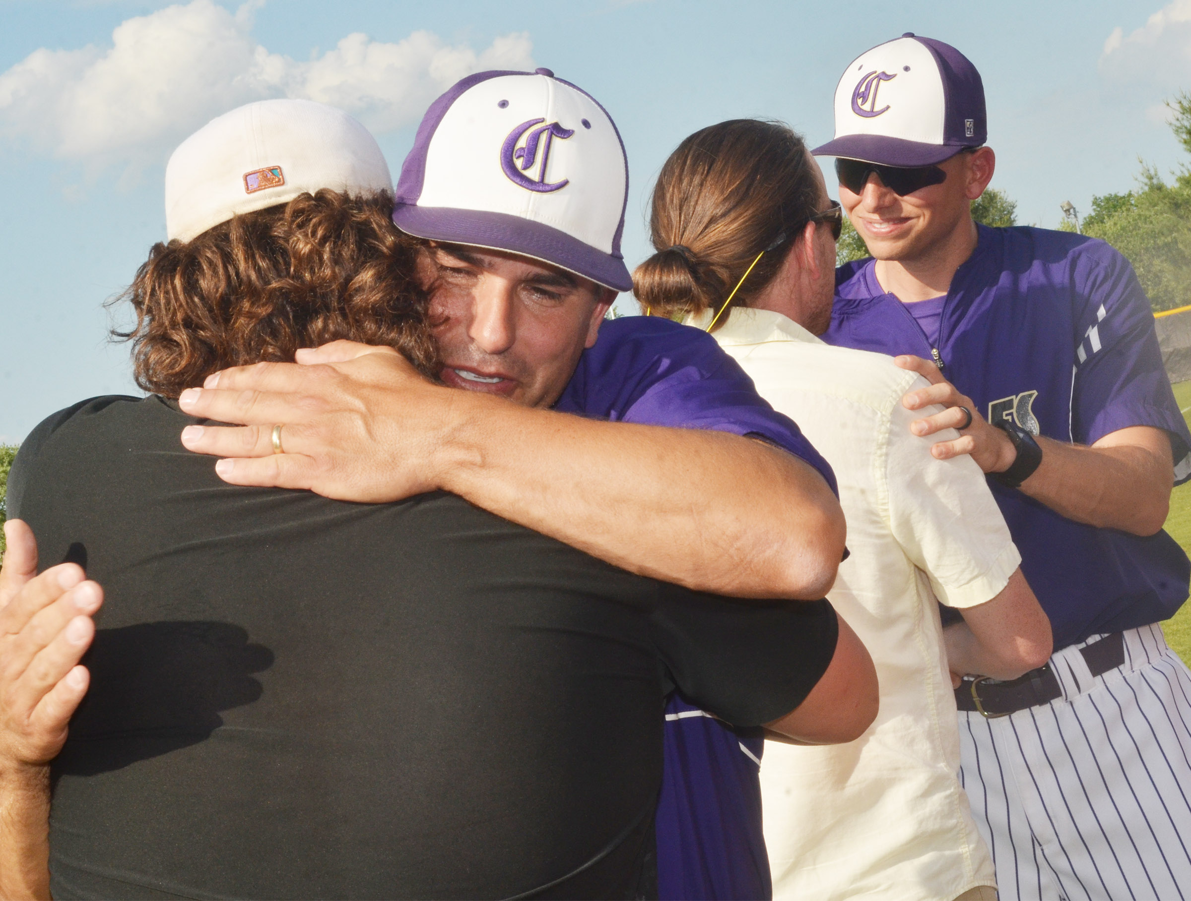 CHS head baseball coach Kirby Smith hugs his former players who surprised him by attending a ceremony honoring him for completing his 11th season leading the Eagles.