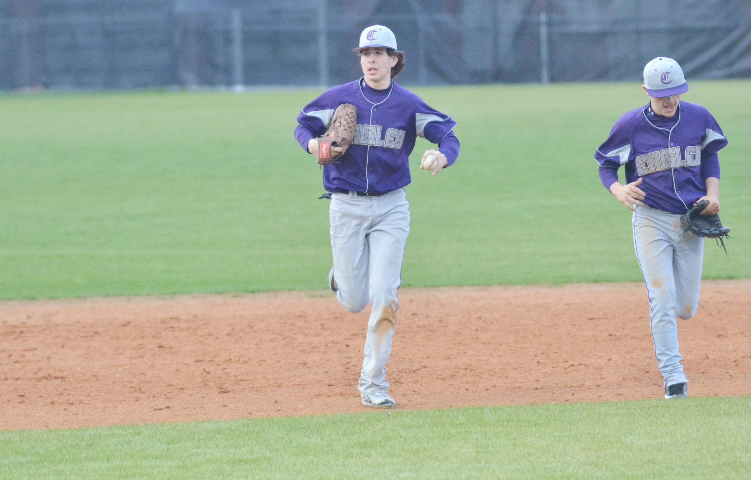 Campbellsville Middle School eighth-grader John Orberson, at left, and CHS sophomore Ryan Kearney run to the dugout.