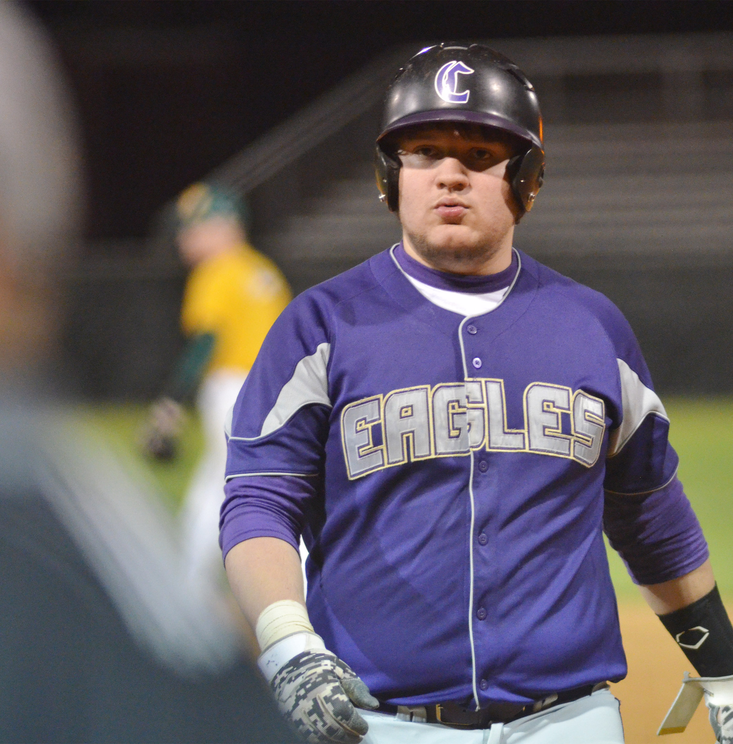 CHS senior Donnie Osinger walks to the dugout.