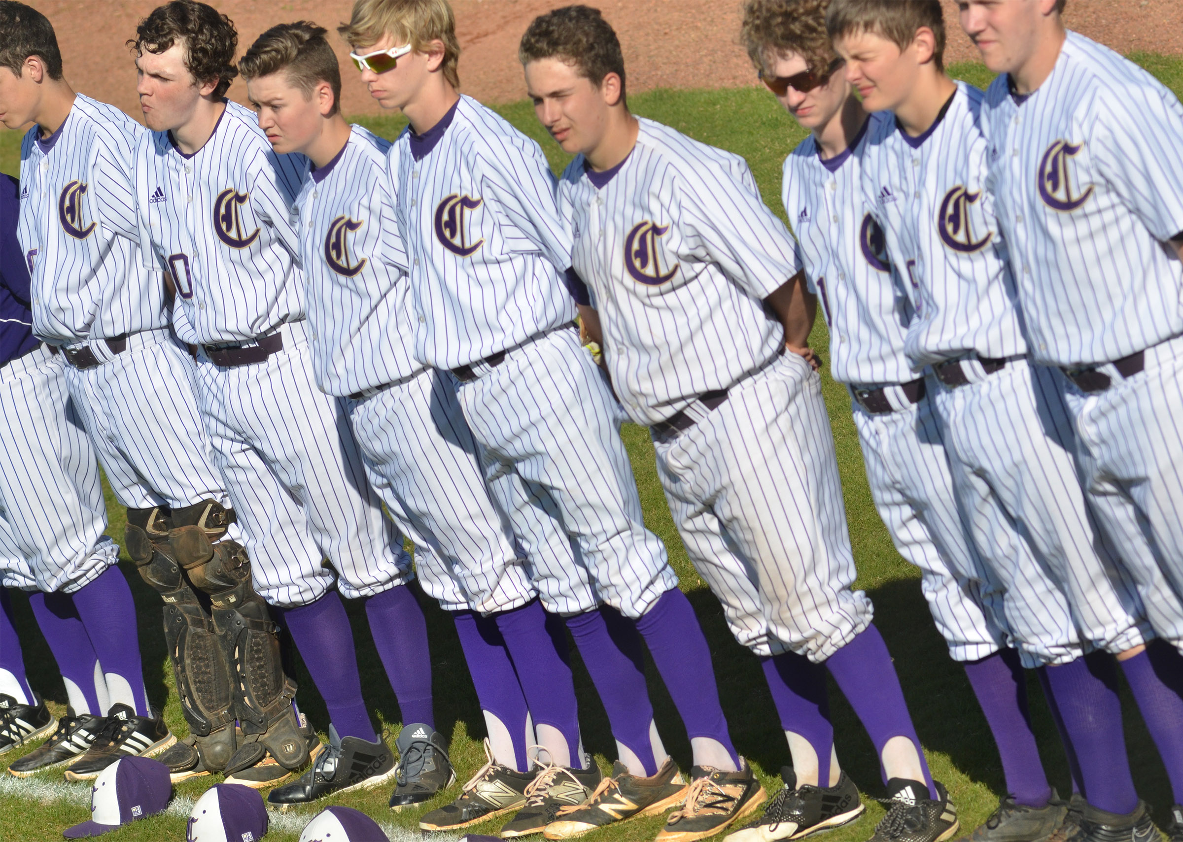 CHS baseball players stand for the National Anthem.