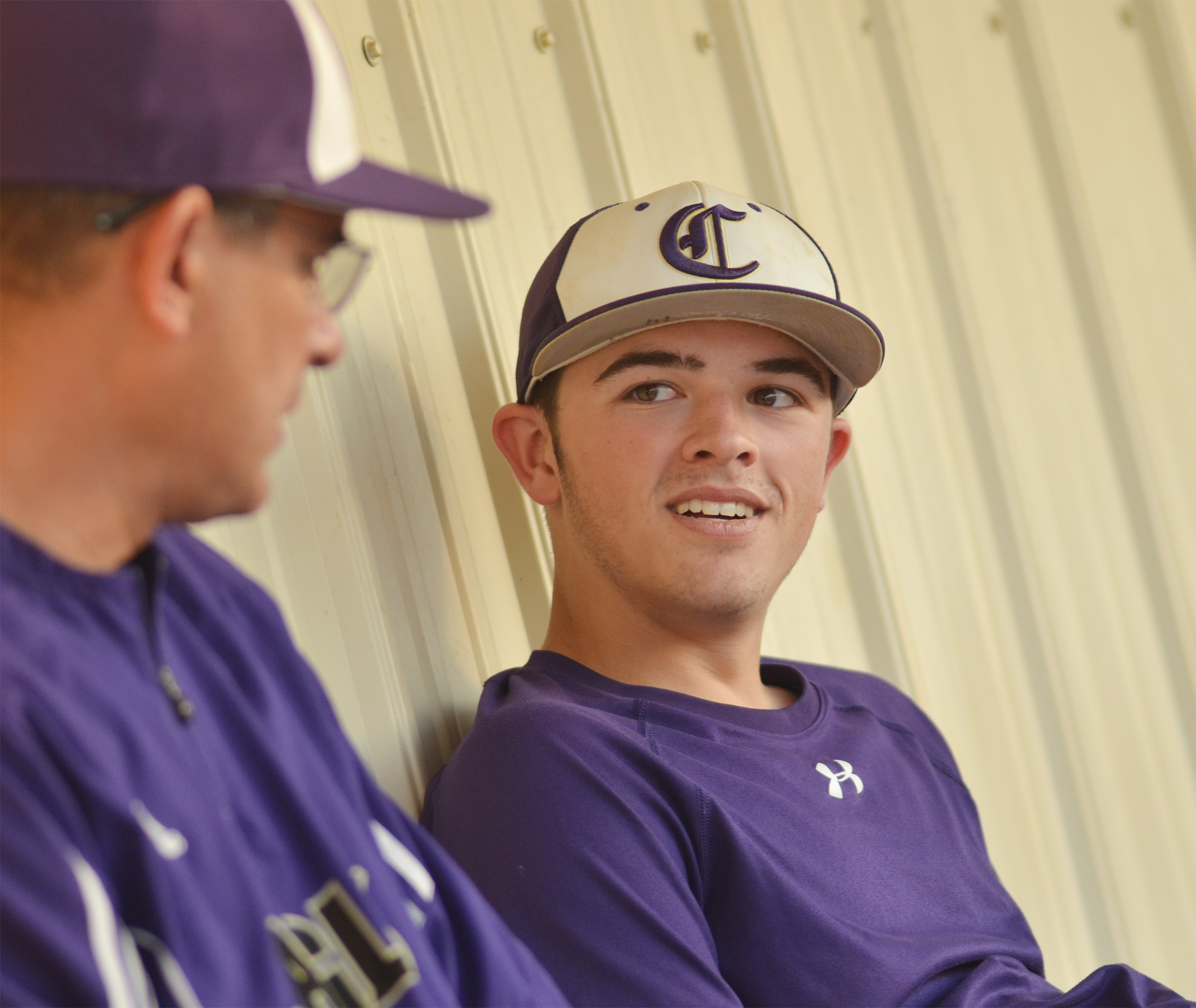 CHS sophomore Ryan Kearney talks with head coach Kirby Smith during the junior varsity game.