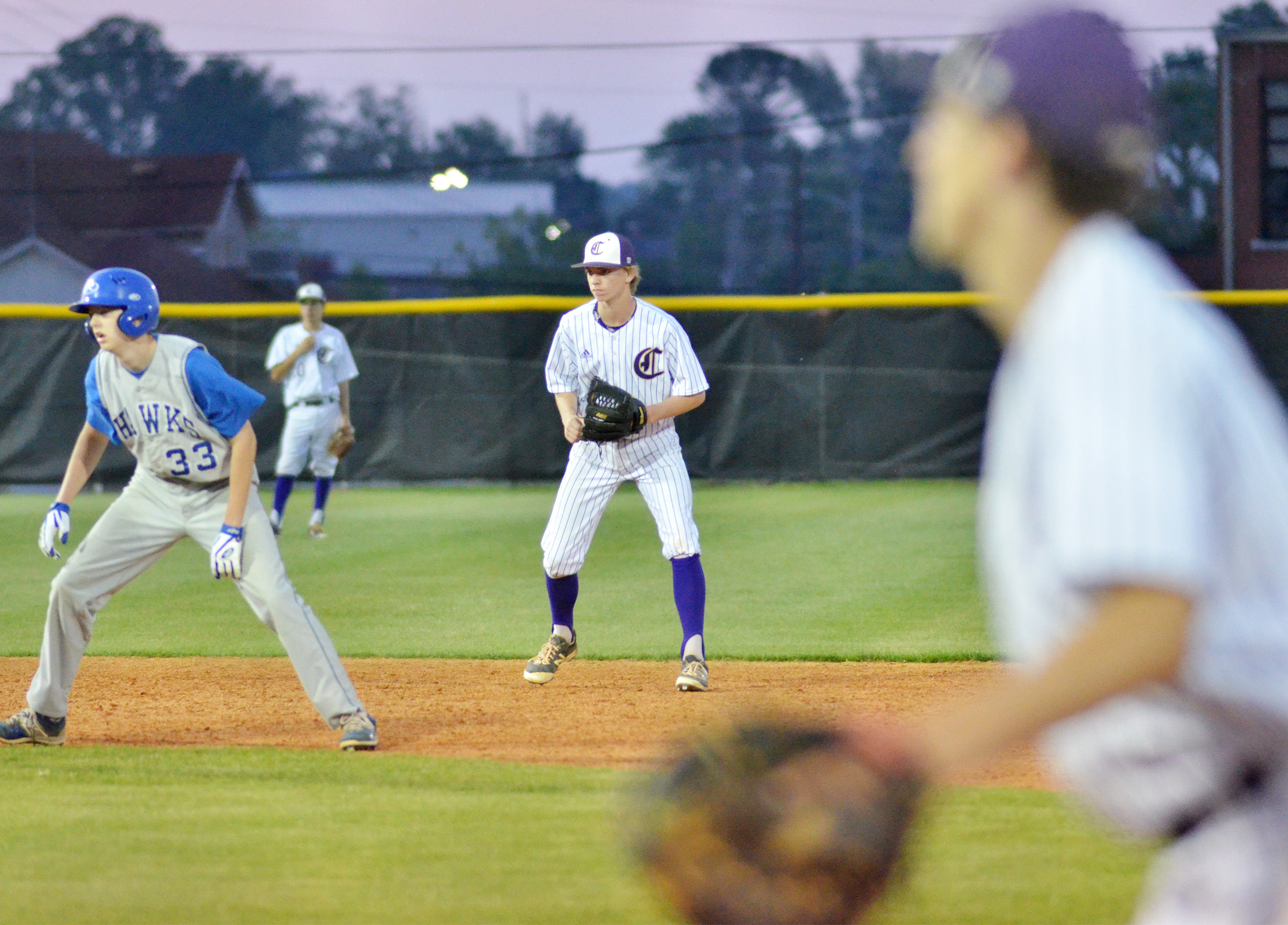 Campbellsville Middle School eighth-grader Arren Hash keeps the runner close at second.