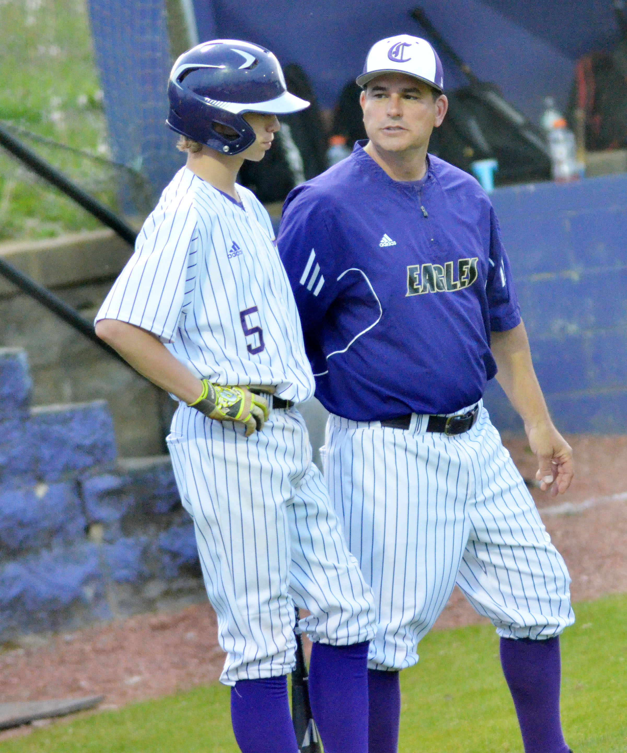 CHS head coach Kirby Smith talks to Campbellsville Middle School eighth-grader Arren Hash as he bats.