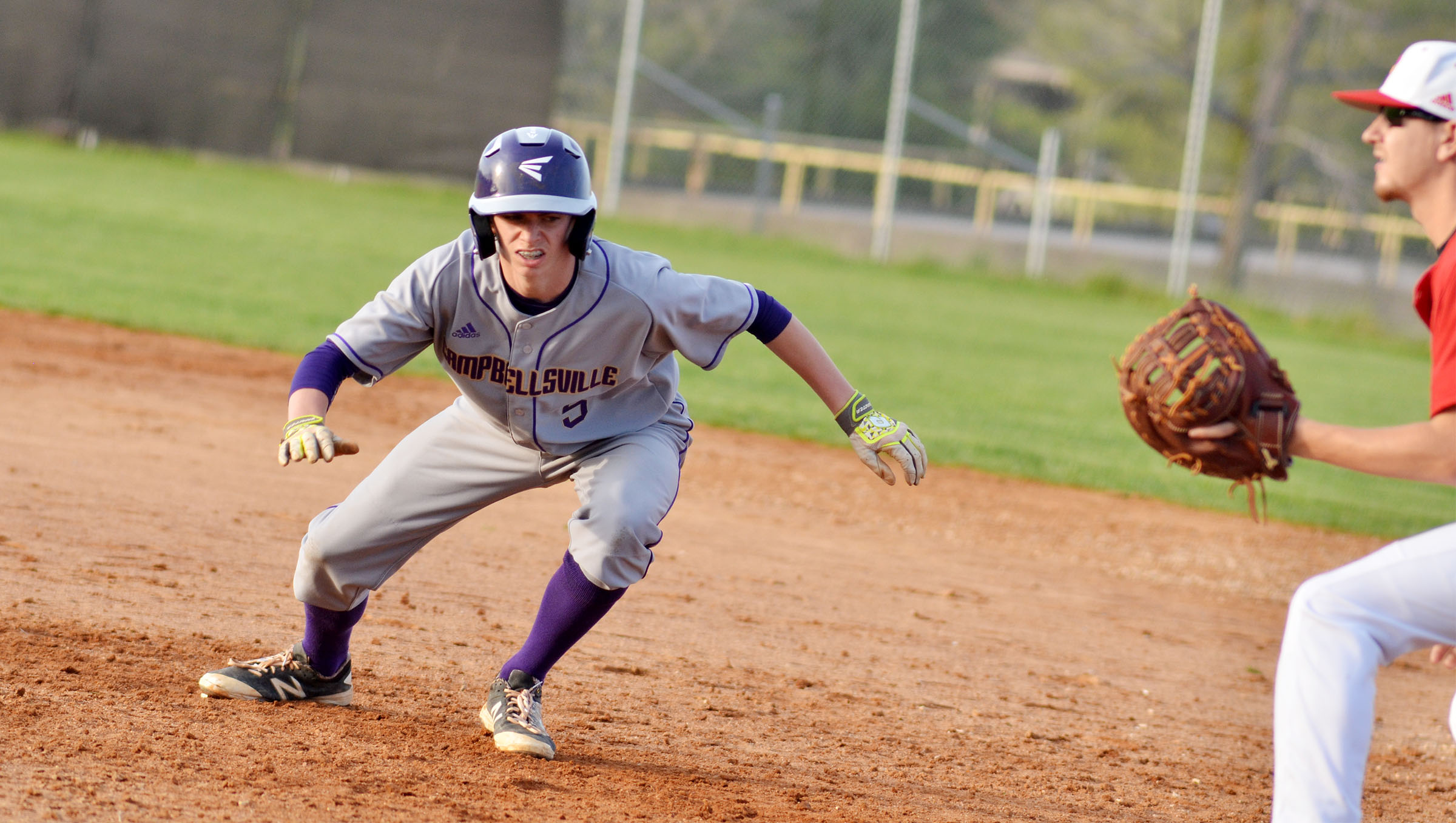Campbellsville Middle School eighth-grader Arren Hash runs back to first base.