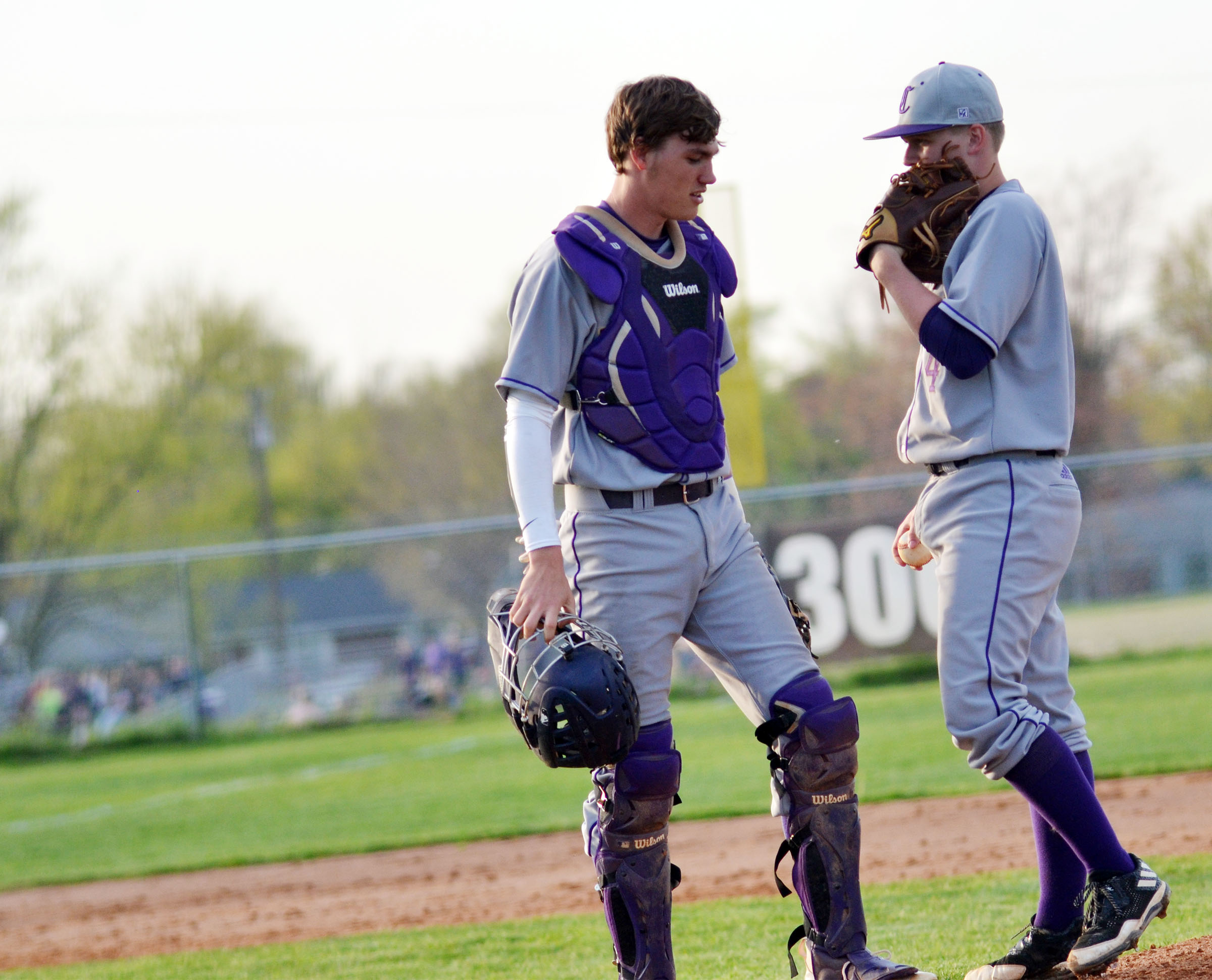 CHS senior Zack Bottoms, at left, and junior Wyatt Houk talk about a batter.