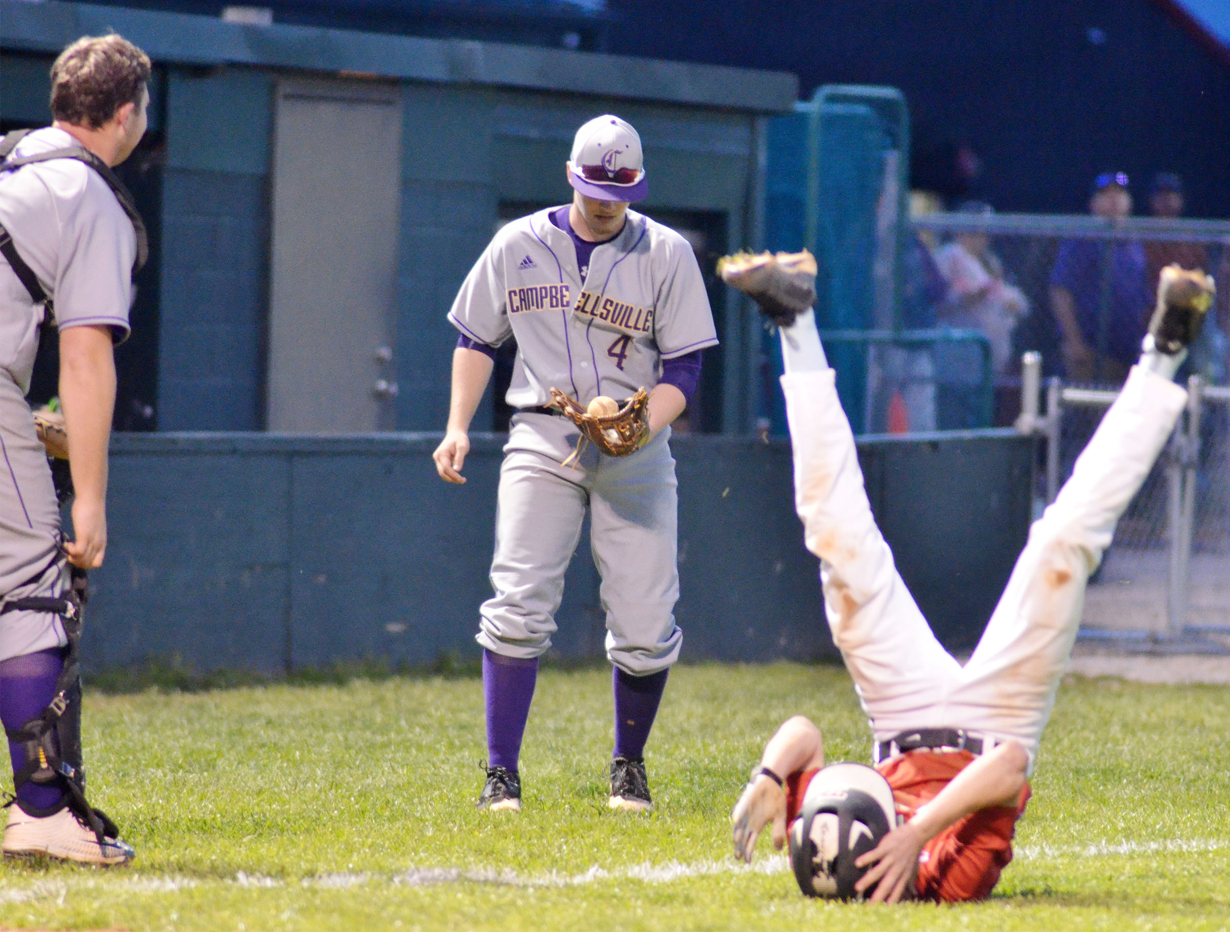 CHS junior Wyatt Houk gets an out as a Taylor County player takes a tumble.