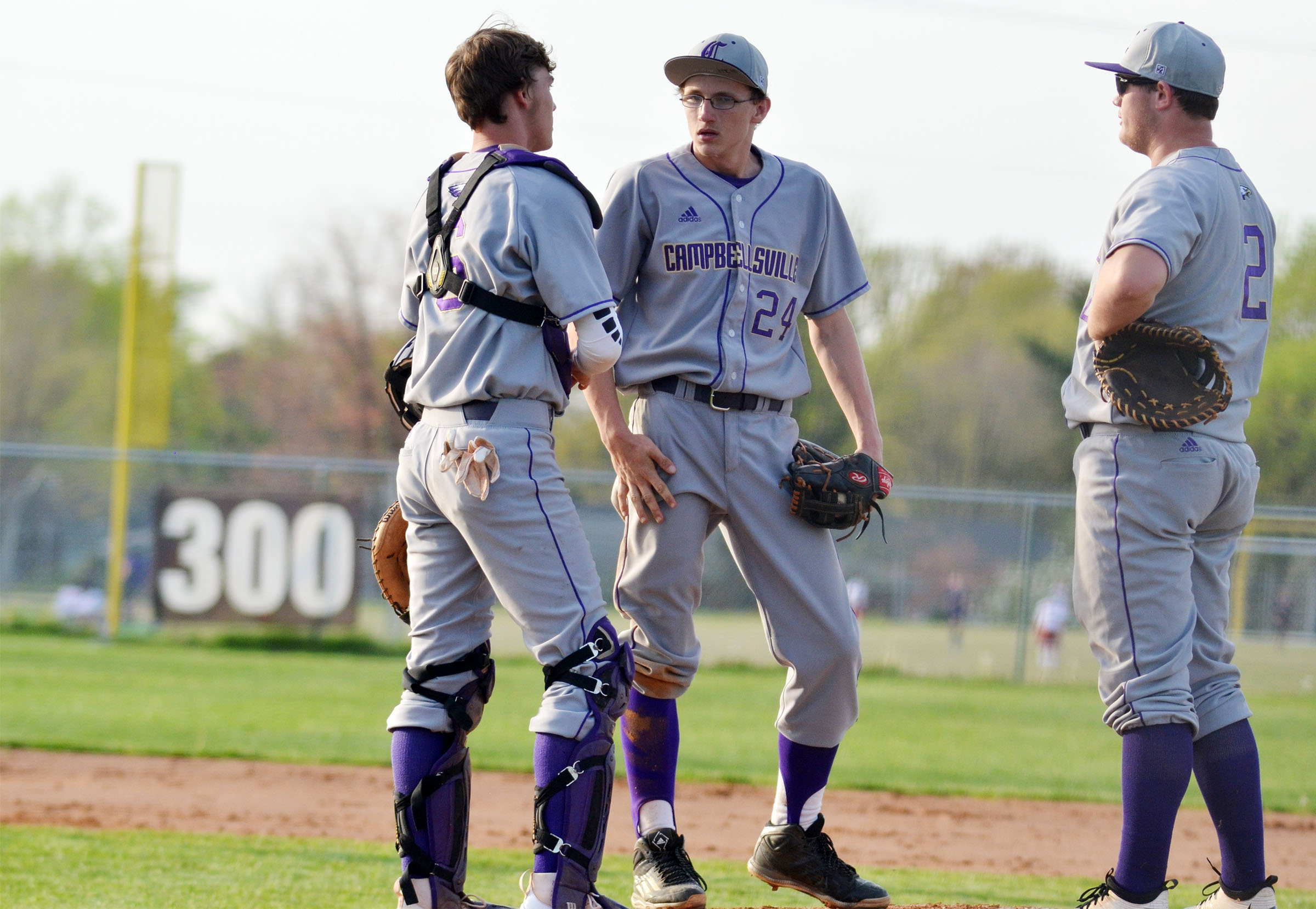 CHS senior Zack Bottoms, at left, talks to freshman Brennon Wheeler and sophomore Lane Bottoms during an inning.