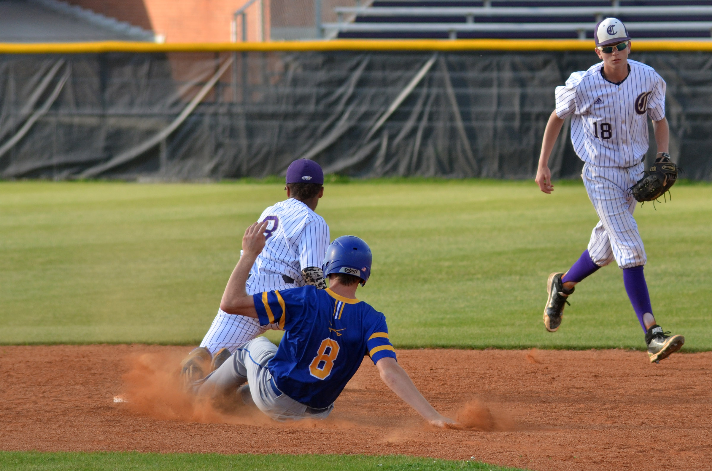 CHS junior Ethan Lay gets an out at second, with help from freshman Noah Hughes.