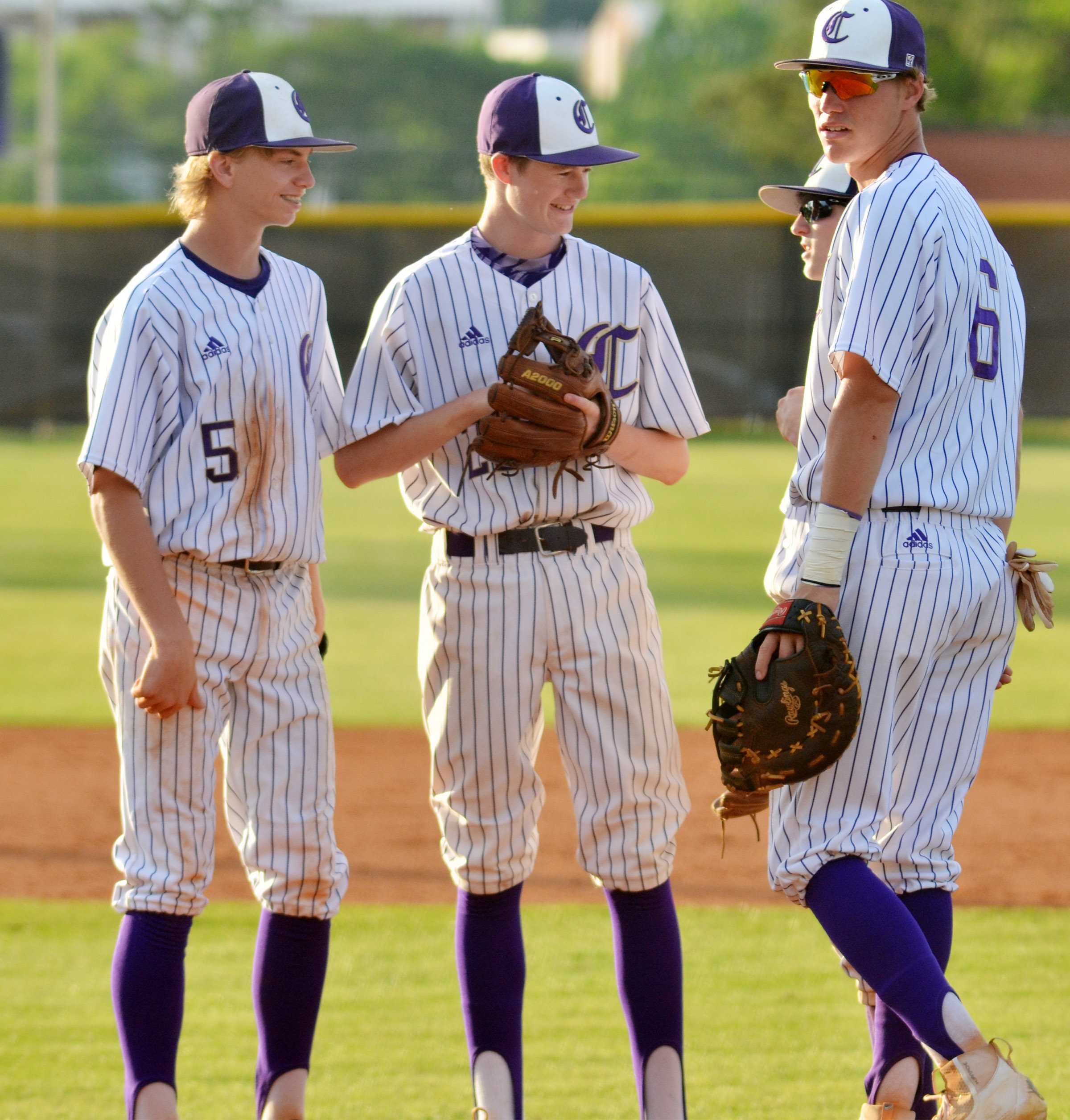 CHS senior Zack Bottoms, at right, talks to, from left, Campbellsville Middle School eighth-graders Arren Hash and Tristin Faulkner and CHS sophomore Jackson Hinton between innings.
