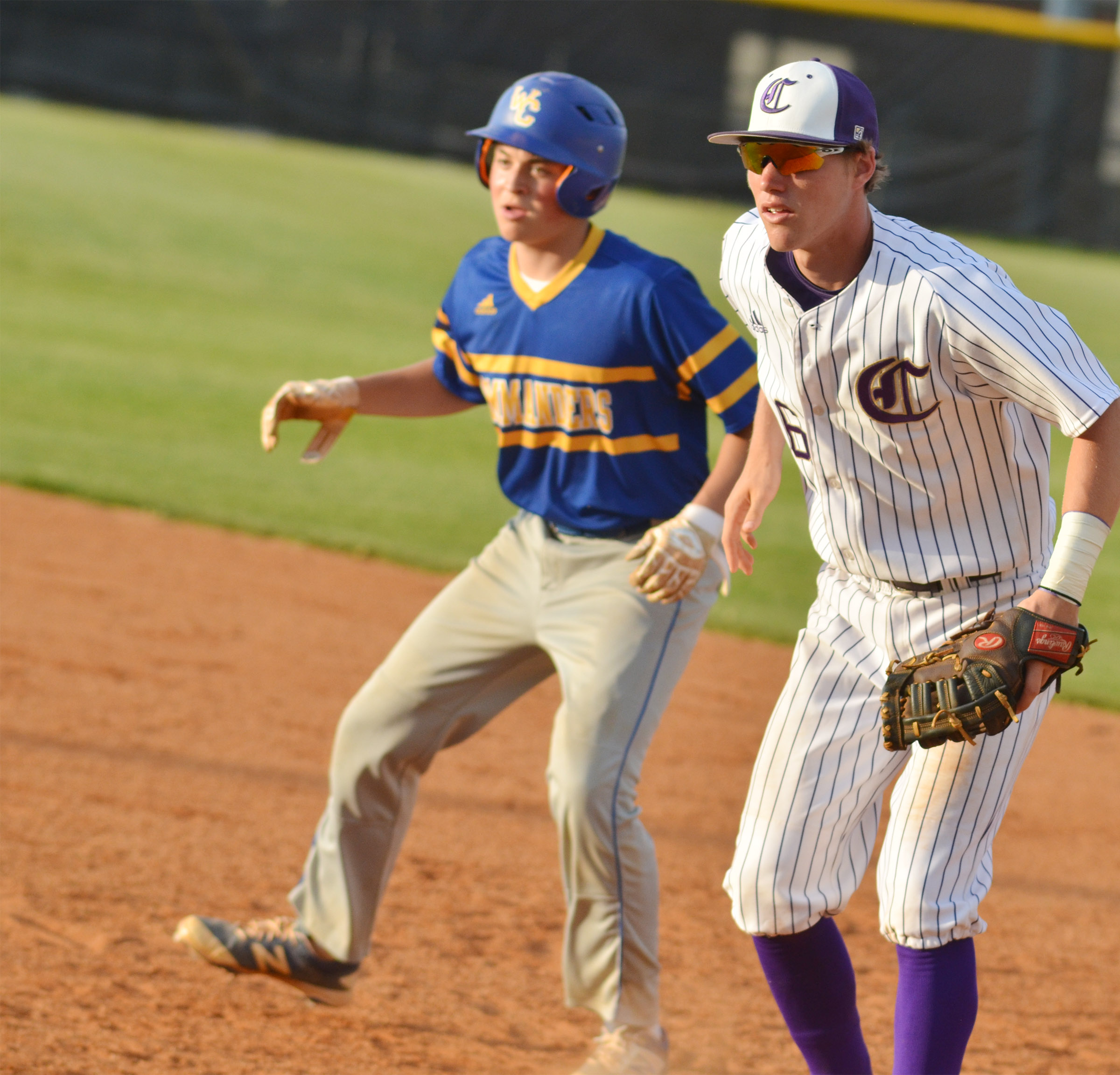 CHS senior Zack Bottoms keeps the runner close at first.