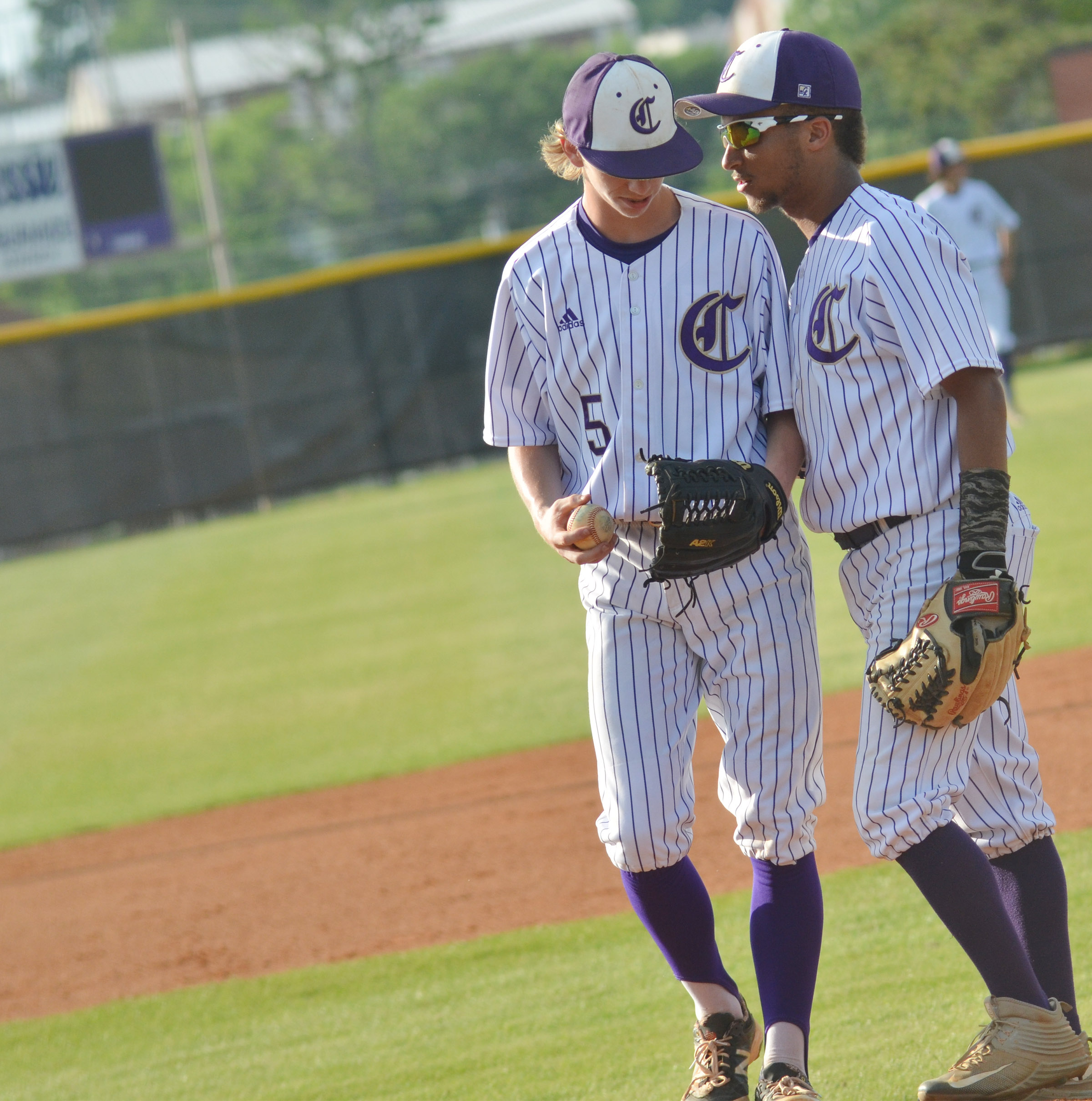 CHS junior Ethan Lay, at right, talks to Campbellsville Middle School eighth-grader Arren Hash on the mound.