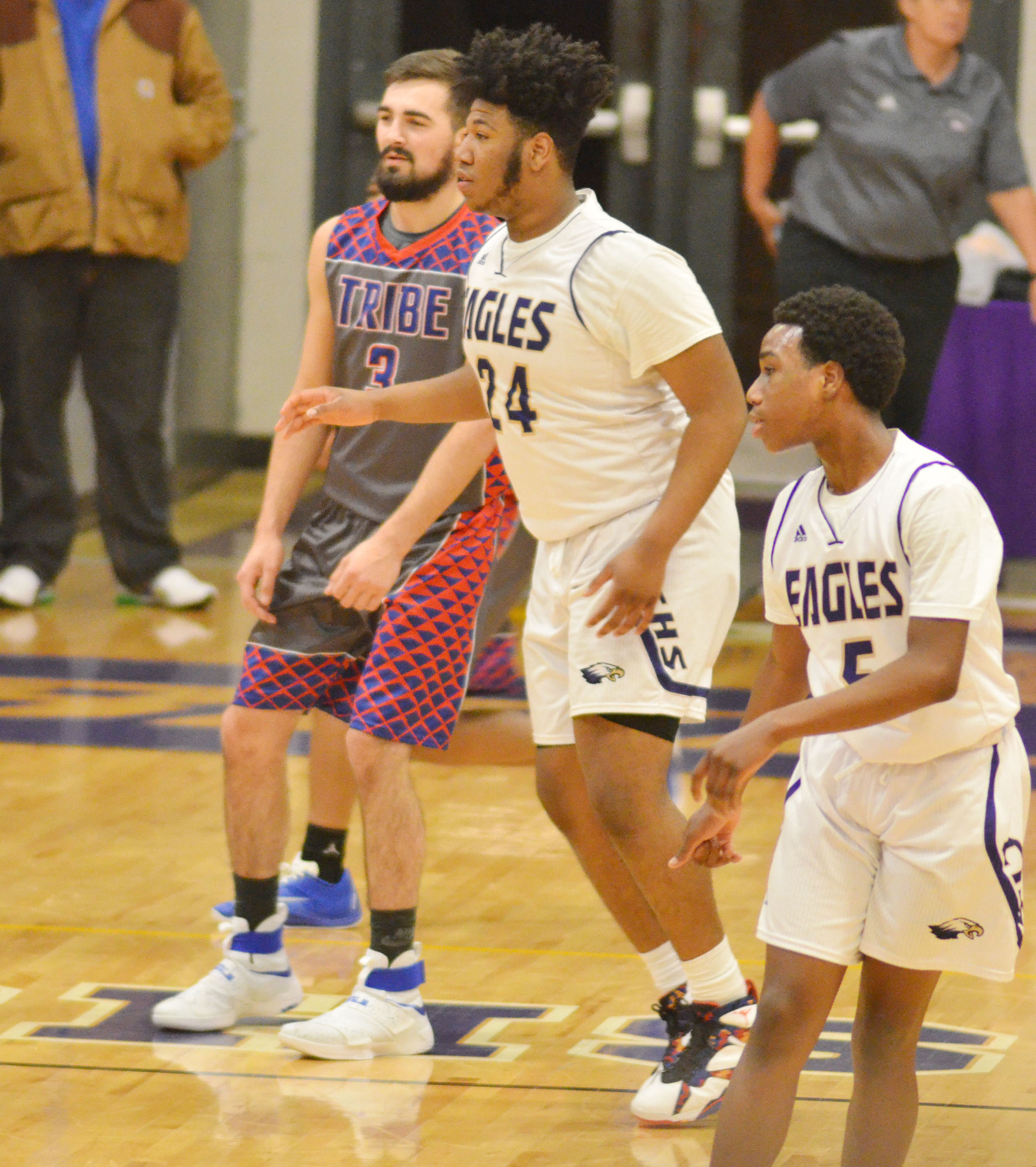 CHS senior Micah Corley, center, and his brother, Malachi, a freshman, play defense.