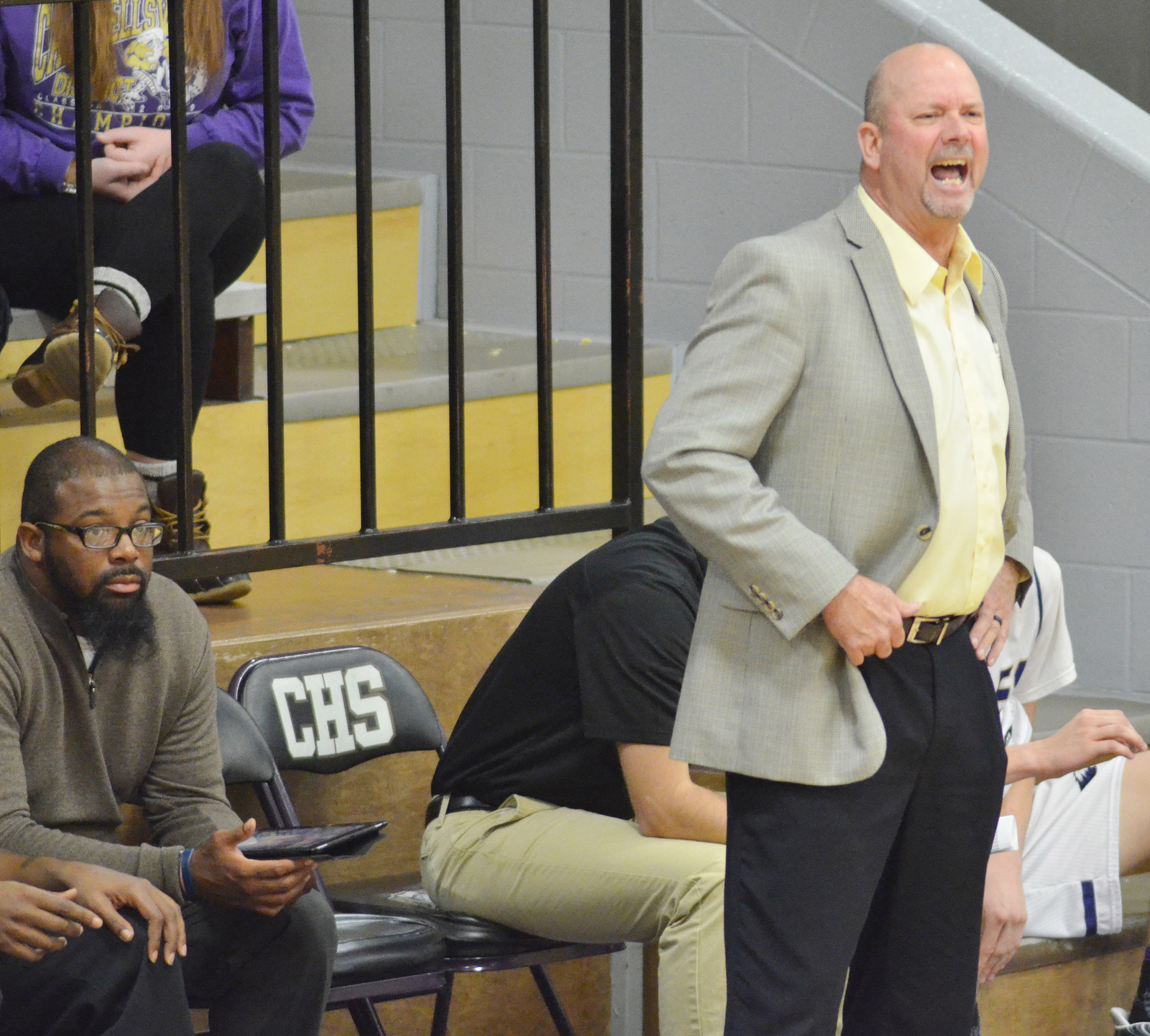 CHS head boys' basketball coach Tim Davis yells to his players.