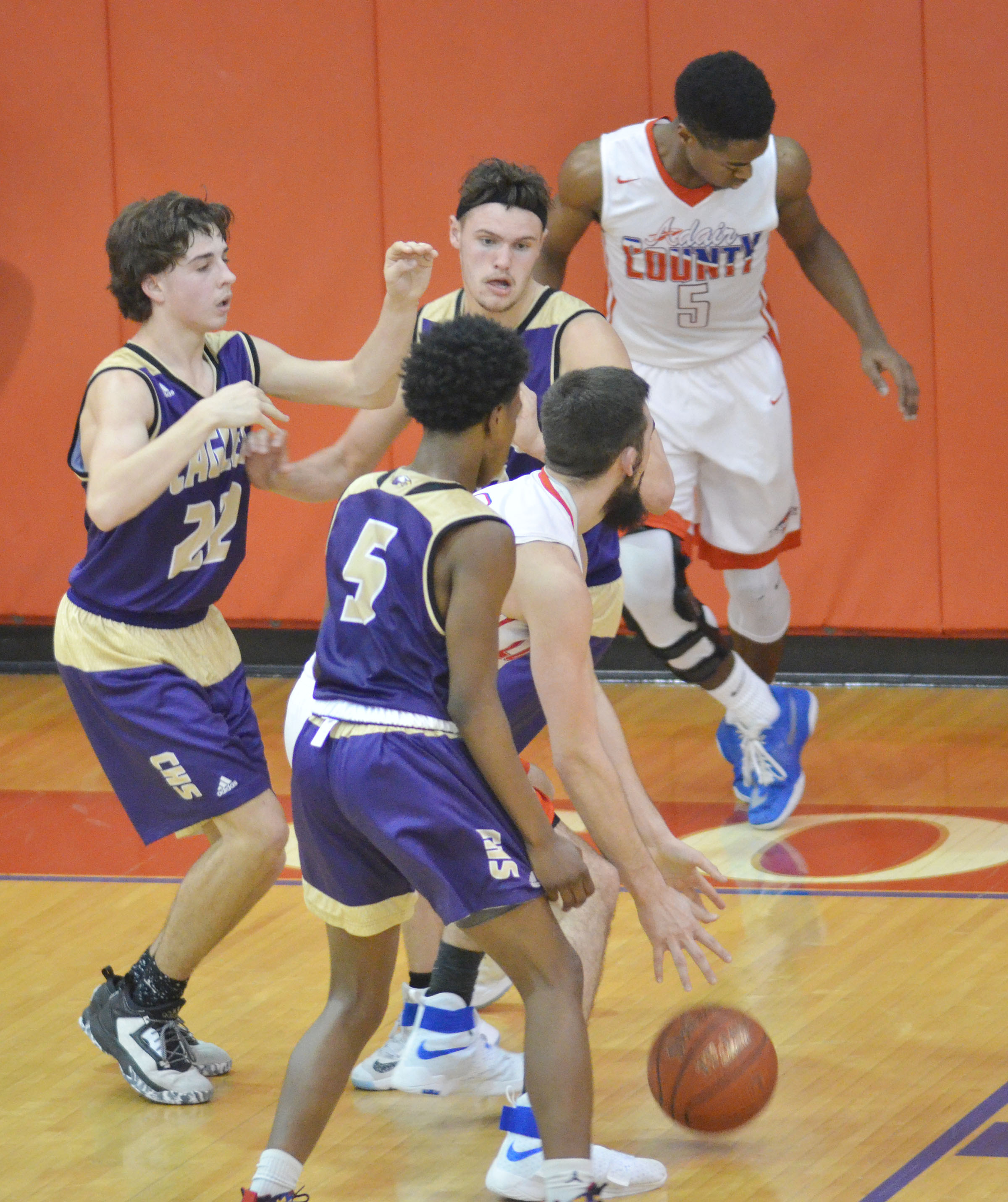 CHS freshman Malachi Corley, in front, plays defense as teammates Campbellsville Middle School eighth-grader John Orberson, at left, and CHS junior Logan Cole guard an Adair County player.